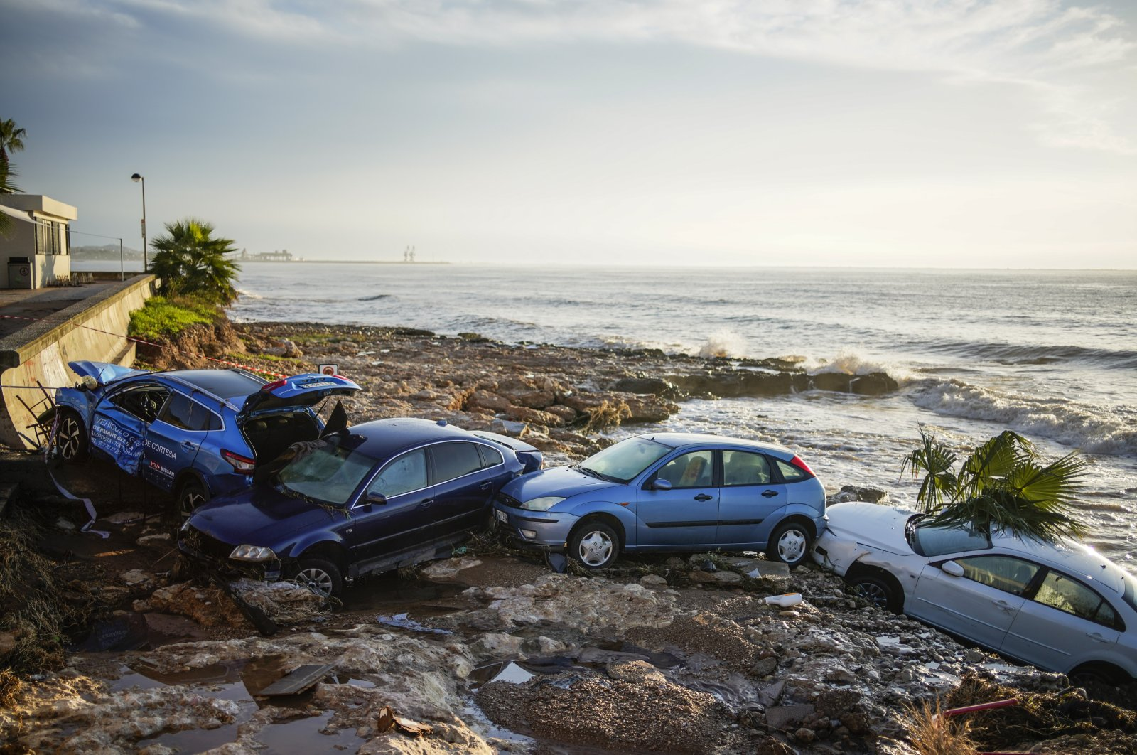 Wrecked cars stuck in the shore of the seaside town of Alcanar, in northeastern Spain, Sept. 2, 2021. (AP Photo)