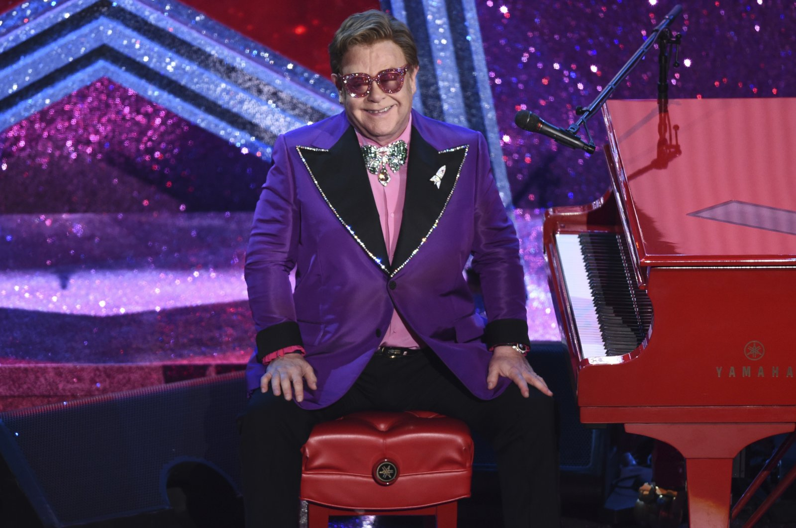 """Sir Elton John sits after performing """"(I'm Gonna) Love Me Again"""" from the film """"Rocketman,"""" which was nominated for the Best Original Song award at the Oscars, at the Dolby Theater, Los Angeles, U.S., Feb. 9, 2020. (AP Photo)"""