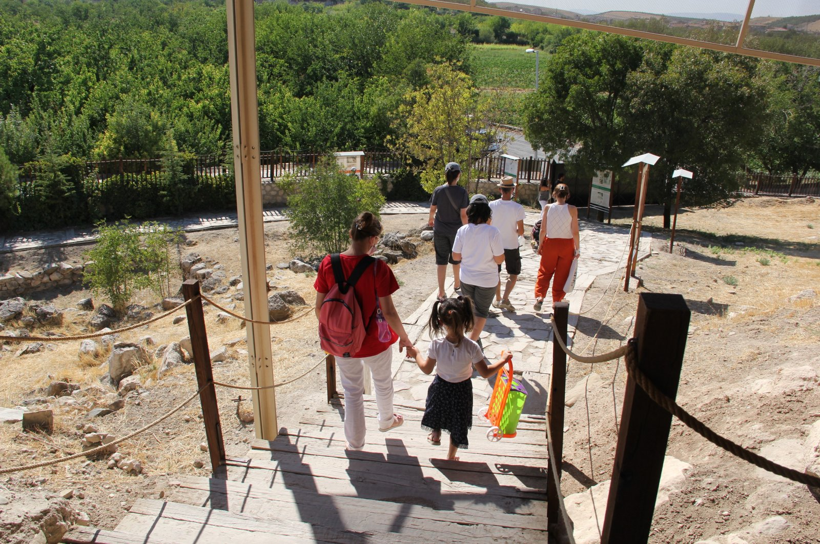 Tourists are seen entering the 7,000-year-old Arslantepe Mound archeological site, Malatya, eastern Turkey, Sept. 2, 2021. (Yeter Erdine / AA Photo)