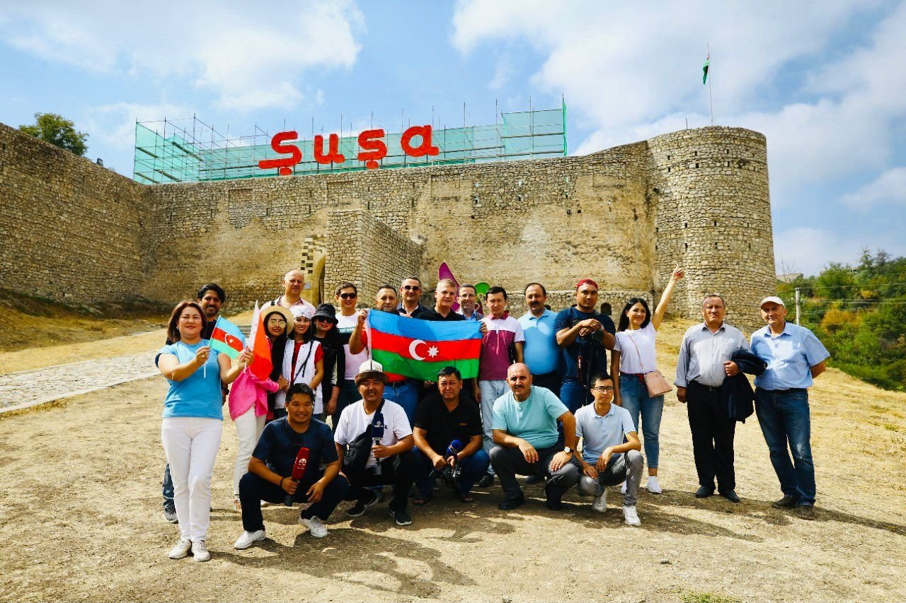 Reporters from Turkic Council member countries pose for a photo in Shusha, Azerbaijan, Sept. 3, 2021. (Photo by Kenan Kıran)