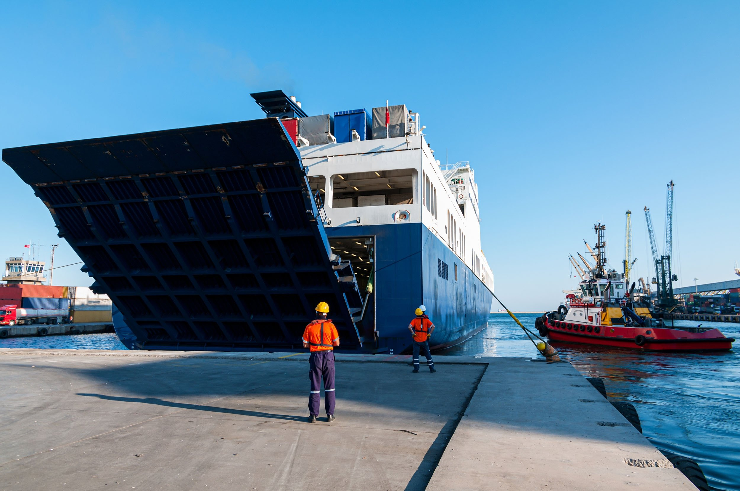 The Open Stern Quarter Ramp Ferry and workers at the Port of Mersin, Turkey. (Shutterstock Photo)