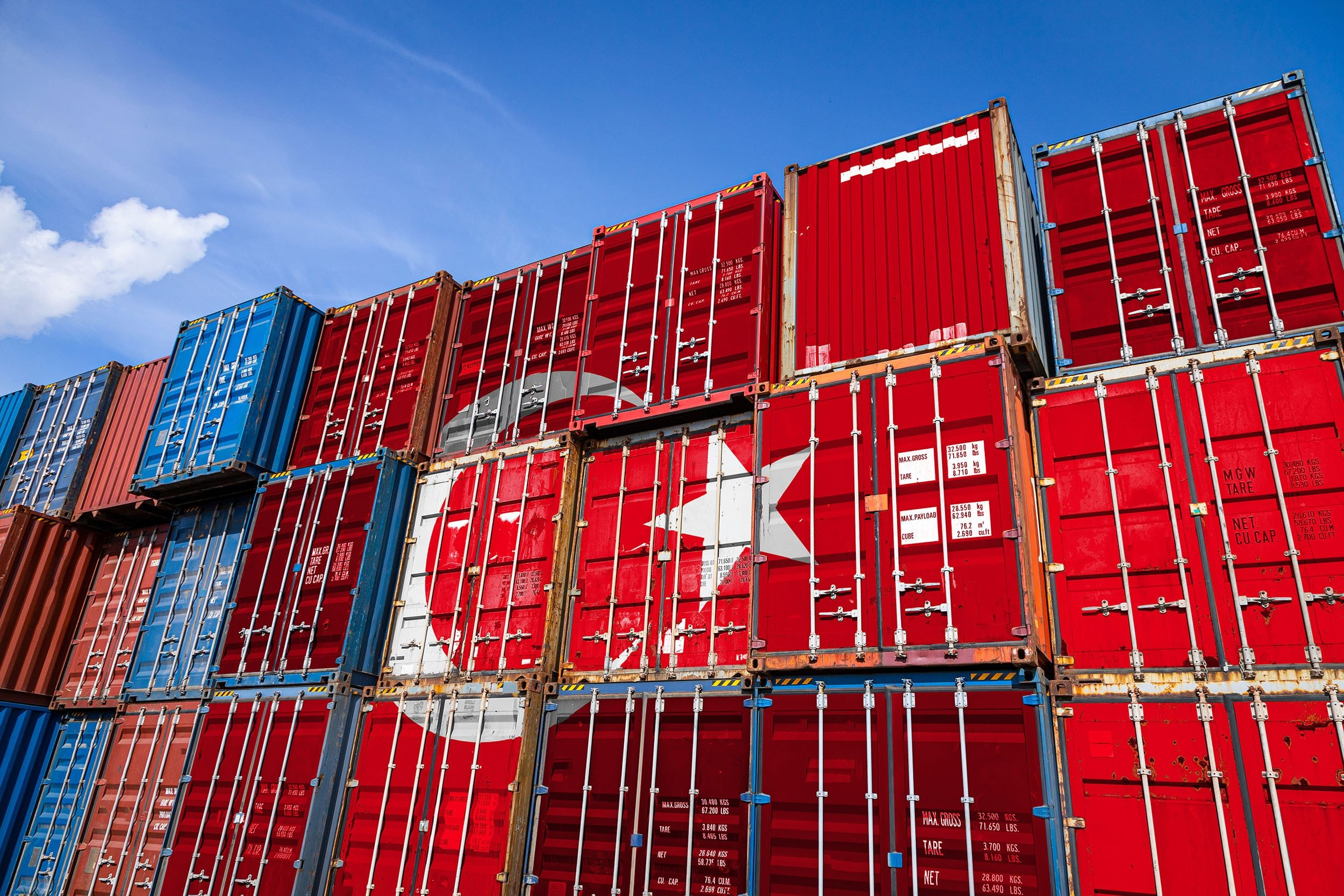 The national flag of Turkey adorns metal containers for storing goods. (Shutterstock Photo)