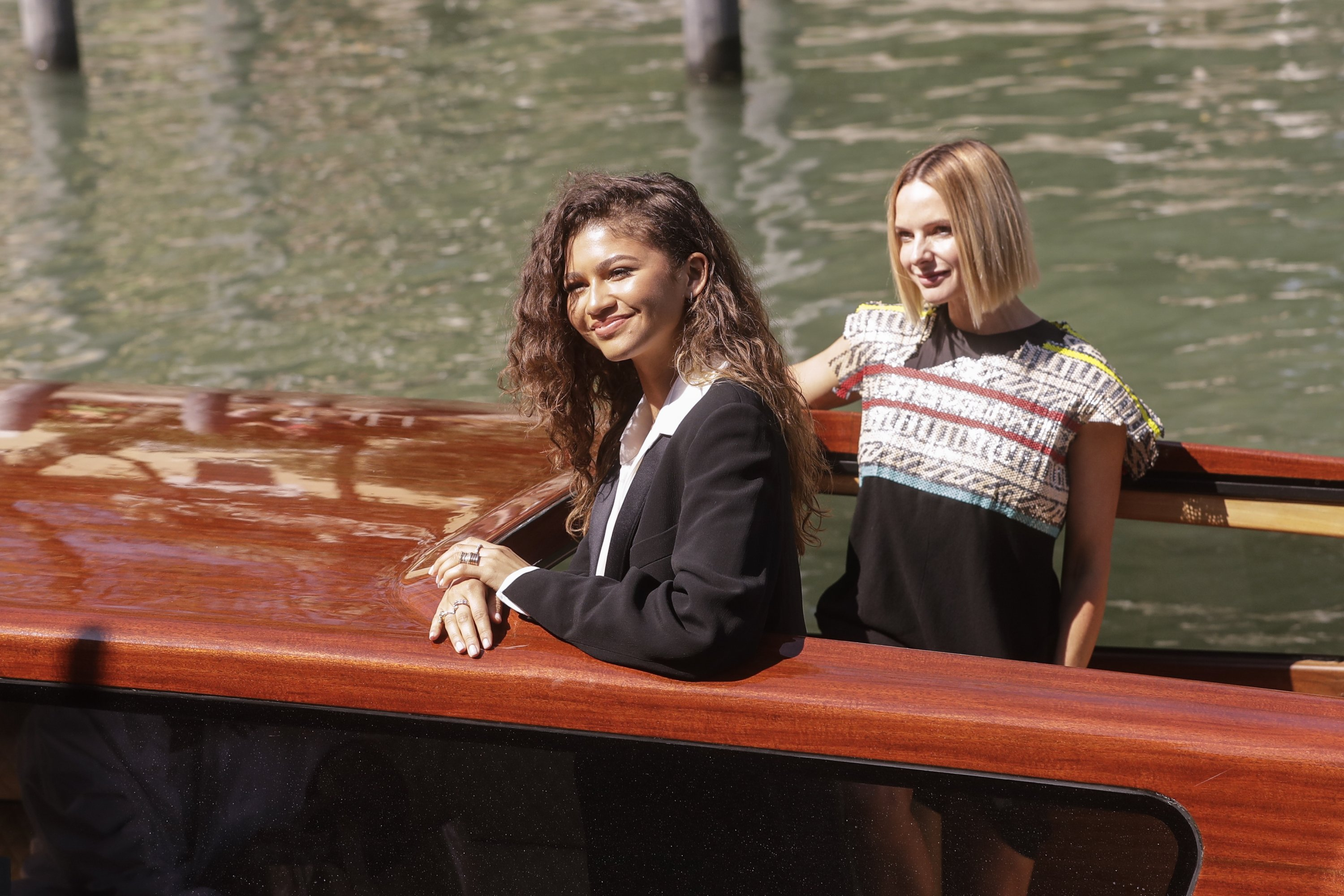 """Zendaya (L) and Rebecca Ferguson arrive for the photocall of the film """"Dune"""" at the 78th edition of the Venice Film Festival in Venice, Italy, Sept. 3, 2021. (AP Photo)"""