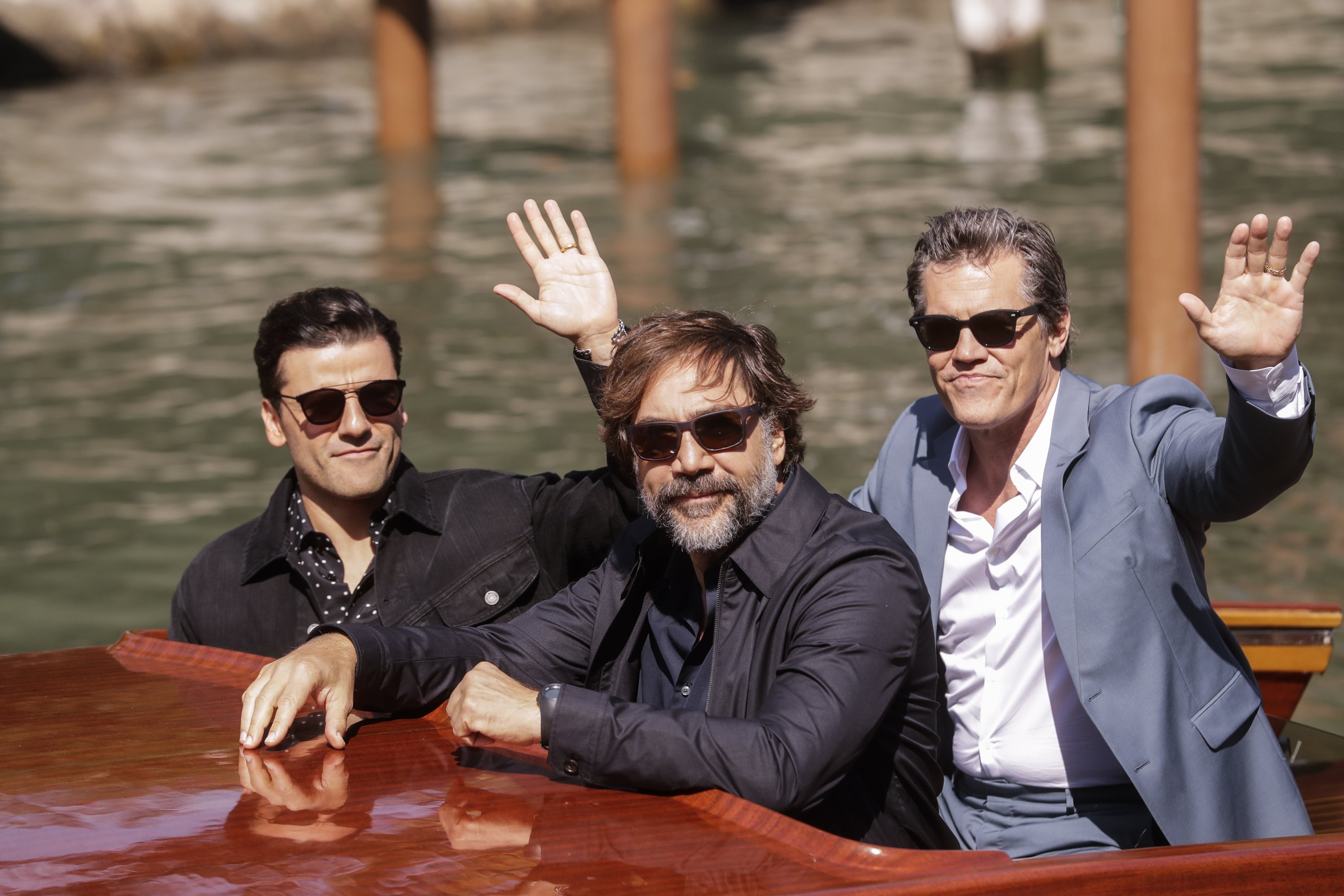 """Oscar Isaac (L), Javier Bardem (C), and Josh Brolin arrive for the photocall of the film """"Dune"""" at the 78th Venice Film Festival in Venice, Italy, Sept. 3, 2021. (AP Photo)"""