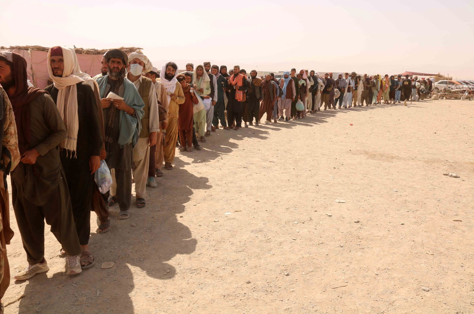 People line up to cross into Afghanistan at Chaman border point, in Pakistan, Sept. 2, 2021. (EPA/STRINGER)