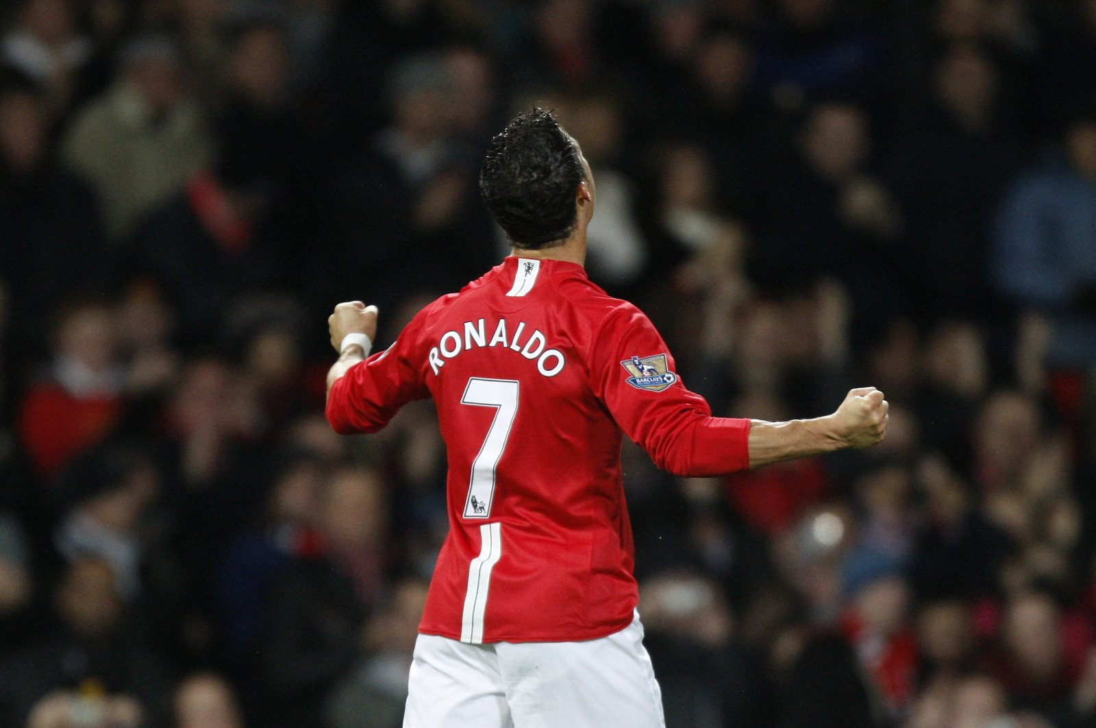 Manchester United's Cristiano Ronaldo celebrates after scoring against West Ham in a Premier League match at Old Trafford Stadium, Manchester, England, Oct. 29, 2008. (AP Photo)