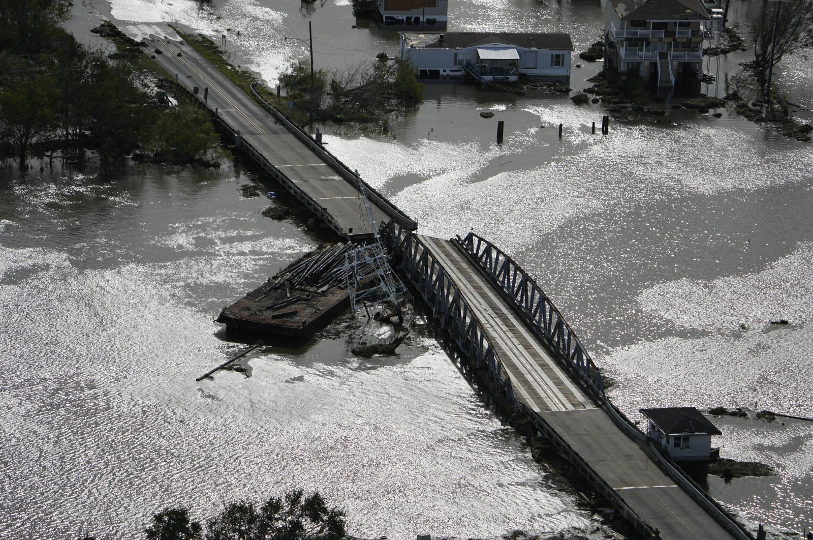 A barge damages a bridge that divides Lafitte, La., and Jean Lafitte, in the aftermath of Hurricane Ida, Aug. 30, 2021, in Lafitte, La. (AP Photo)