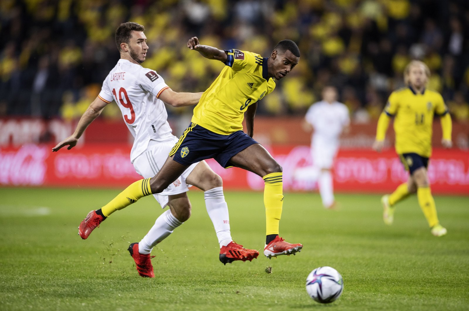 Spain's Aymeric Laporte (L) against Sweden's Alexander Isak during their 2022 FIFA World Cup qualifier match at Friends Arena, Stockholm, Sweden, Sept. 2, 2021. (EPA Photo)