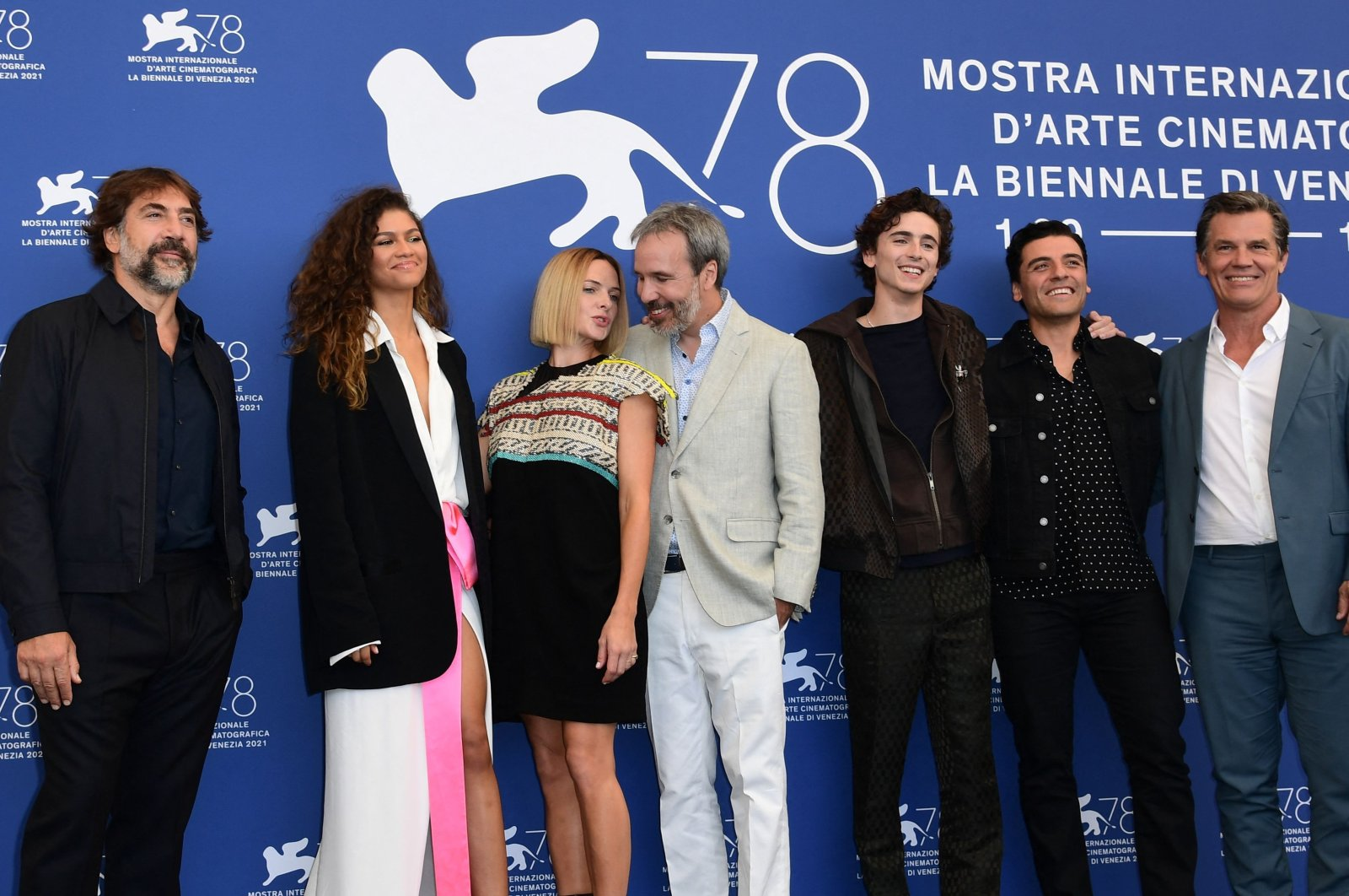 """(L-R) Javier Bardem, Zendaya, Rebecca Ferguson, Denis Villeneuve, Timothee Chalamet, Oscar Isaac and Josh Brolin,attend a photocall for the film """"Dune""""at the 78th Venice Film Festival, in Venice, Italy,Sept.3, 2021. (AFP Photo)"""