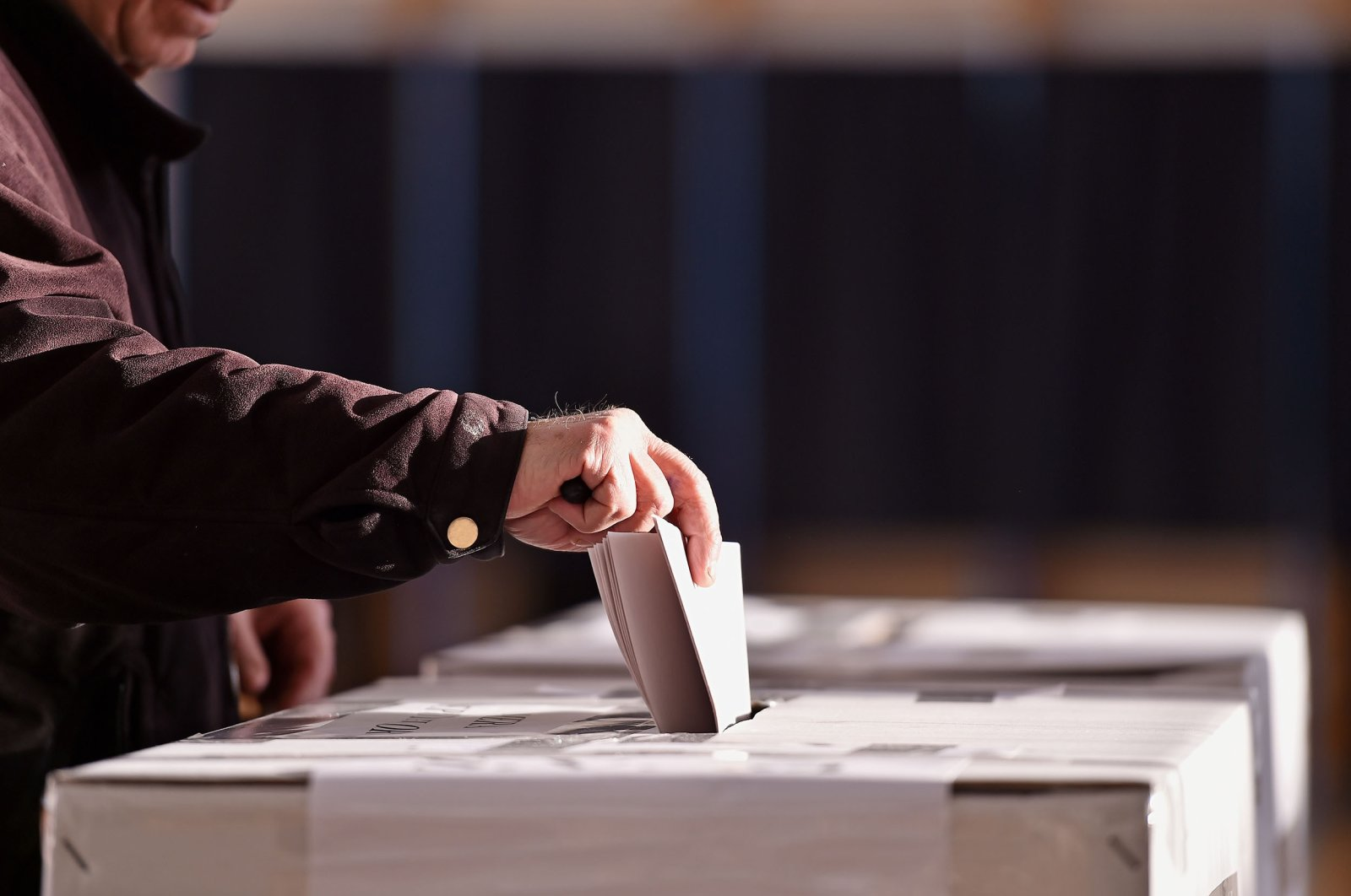 A person casting a vote into the ballot box during elections. (Shutterstock Photo)