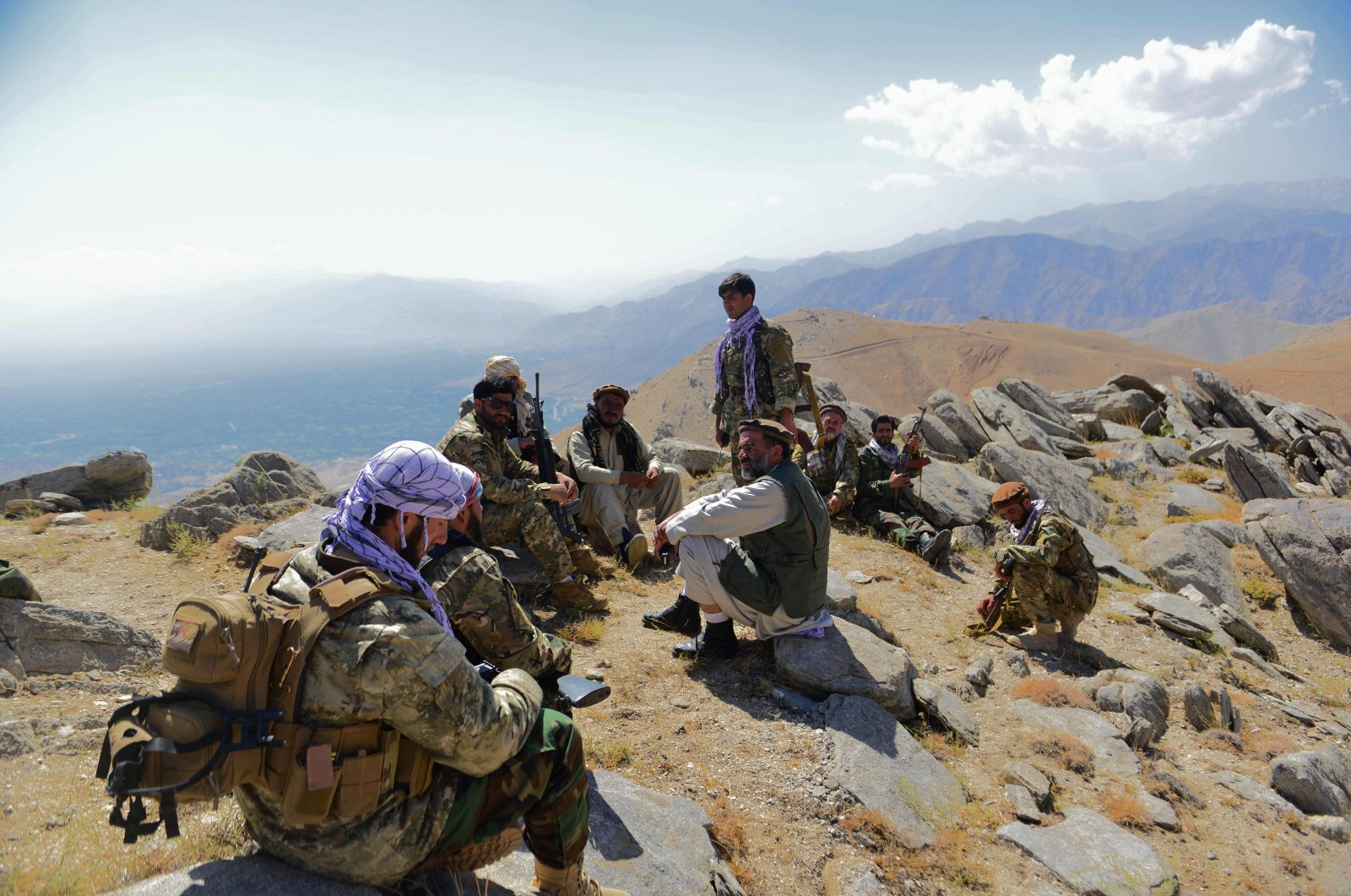 Afghan resistance movement and anti-Taliban uprising forces take rest as they patrol on a hilltop in Darband area in Anaba district, Panjshir province, Afghanistan, Sept. 1, 2021. (AFP Photo)