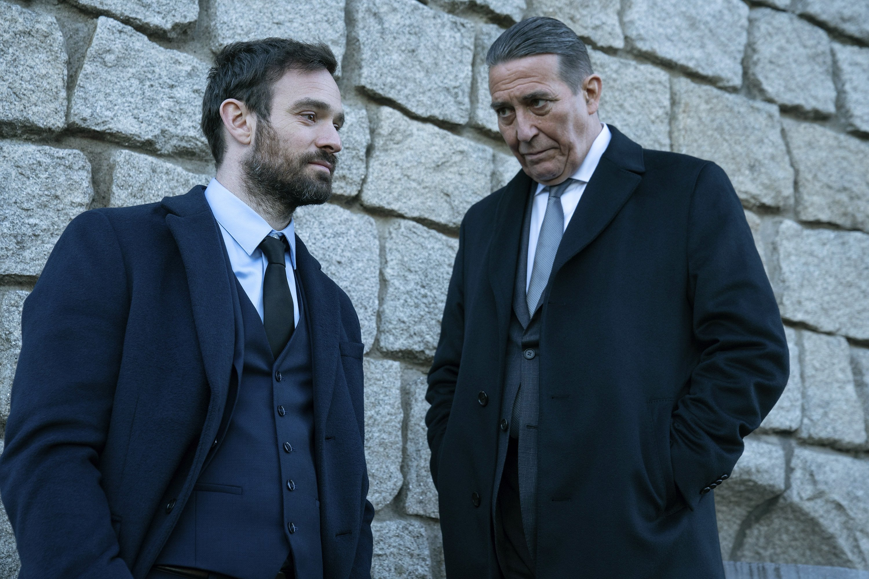 Charlie Cox (L), and Ciarán Hinds, in a scene from the series 'Kin,' premiering on Sept. 9, 2021. (AMC  via AP)