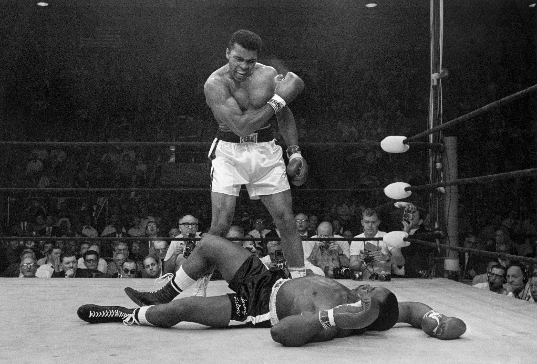 Heavyweight champion Muhammad Ali stands over fallen challenger Sonny Liston, shouting and gesturing shortly after dropping Liston with a short hard right to the jaw, Lewiston, Maine, U.S., May 25, 1965. (AP Photo)
