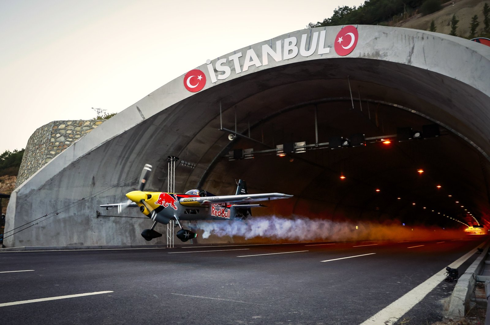 A handout photo made available by the Red Bull Press Office shows Italian pilot Dario Costa in action as he flying through the Çatalça Tunnel in Istanbul, Turkey, Sept. 4, 2021. (EPA Photo)