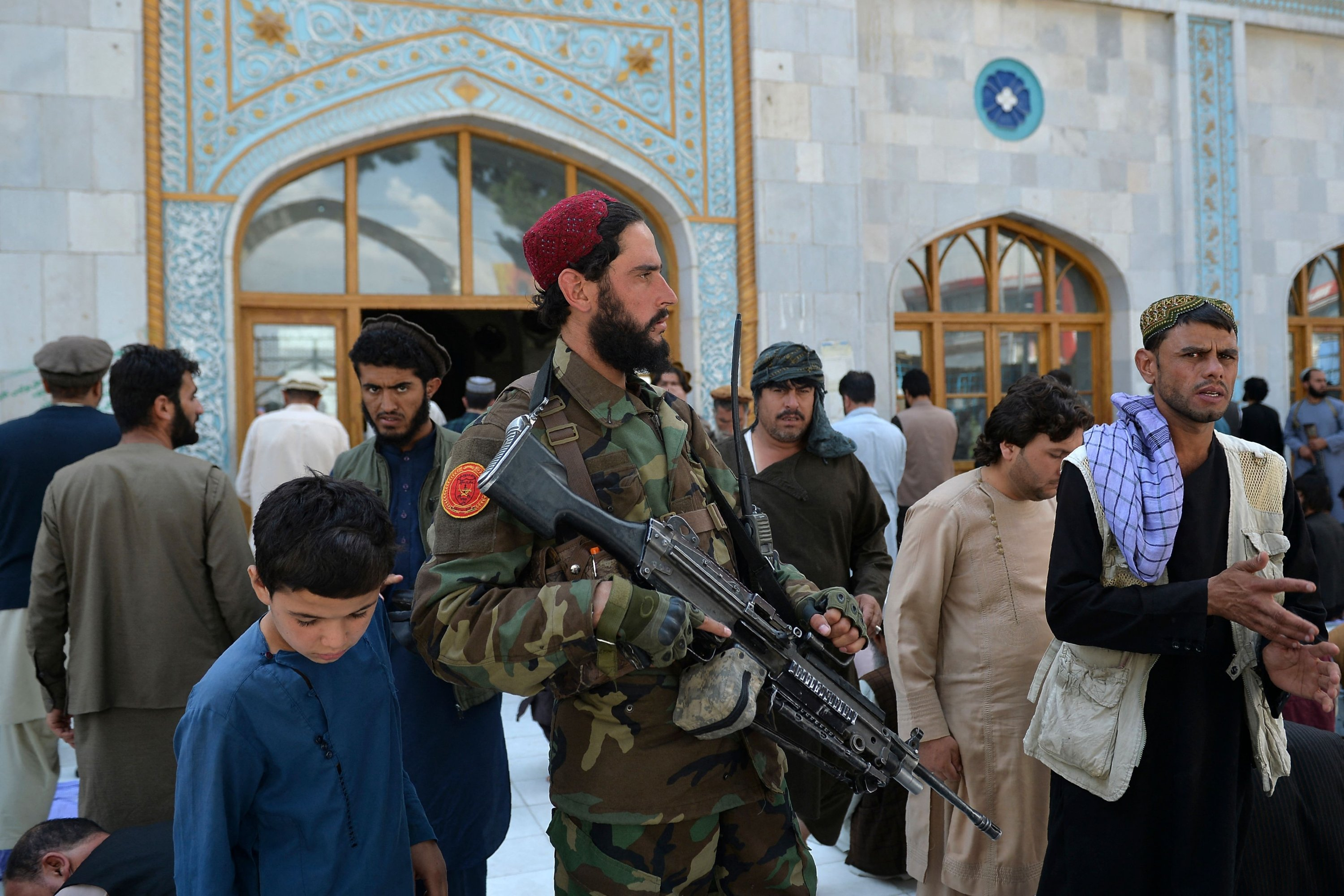 An armed Taliban fighter stands guard as devotees leave after Friday prayers at the Pul-e Khishti Mosque in Kabul, Afghanistan, Sept. 3, 2021. (AFP Photo)