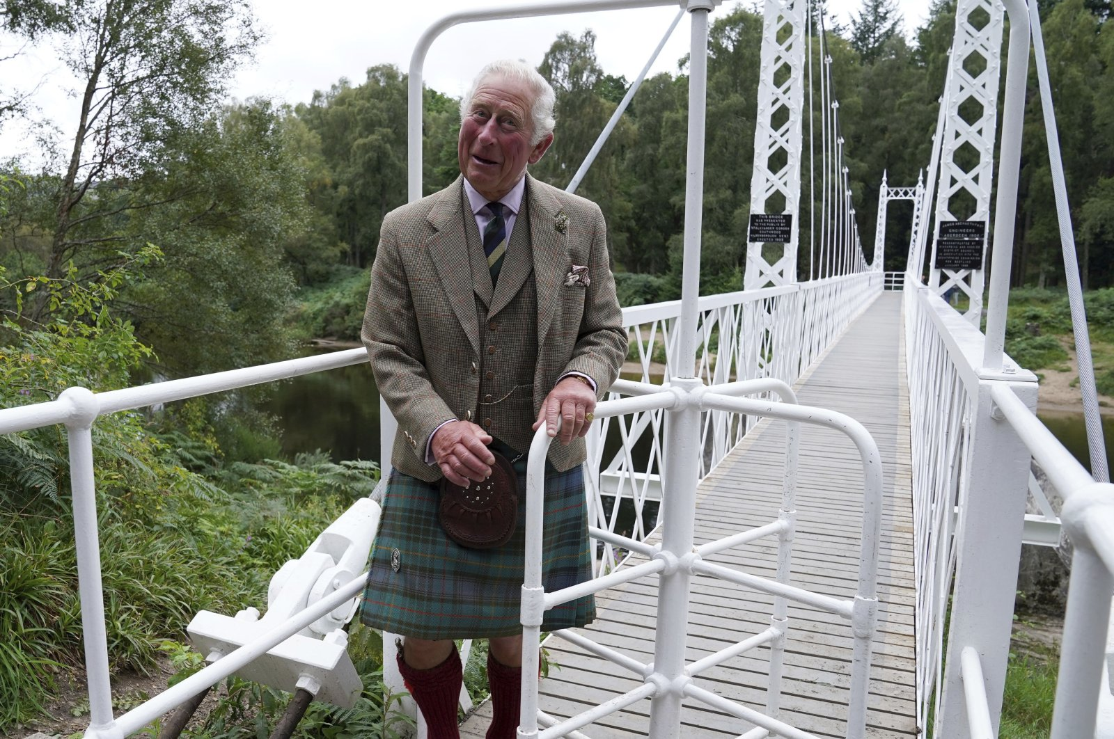Britain's Prince Charles, known as the Duke of Rothesay when in Scotland, reacts during a visit to Cambus O'May suspension bridge following its repair, in Ballater, Scotland, U.K., Aug. 31, 2021. (AP Photo)