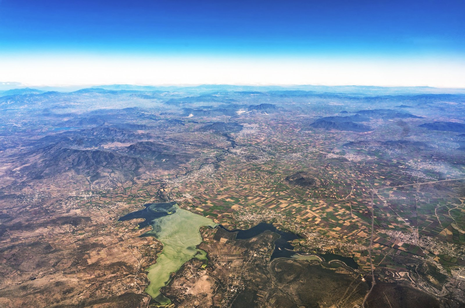 Aerial view of Lake Texcoco, fields and mountains, near Mexico City, Mexico. (Shutterstock Photo)
