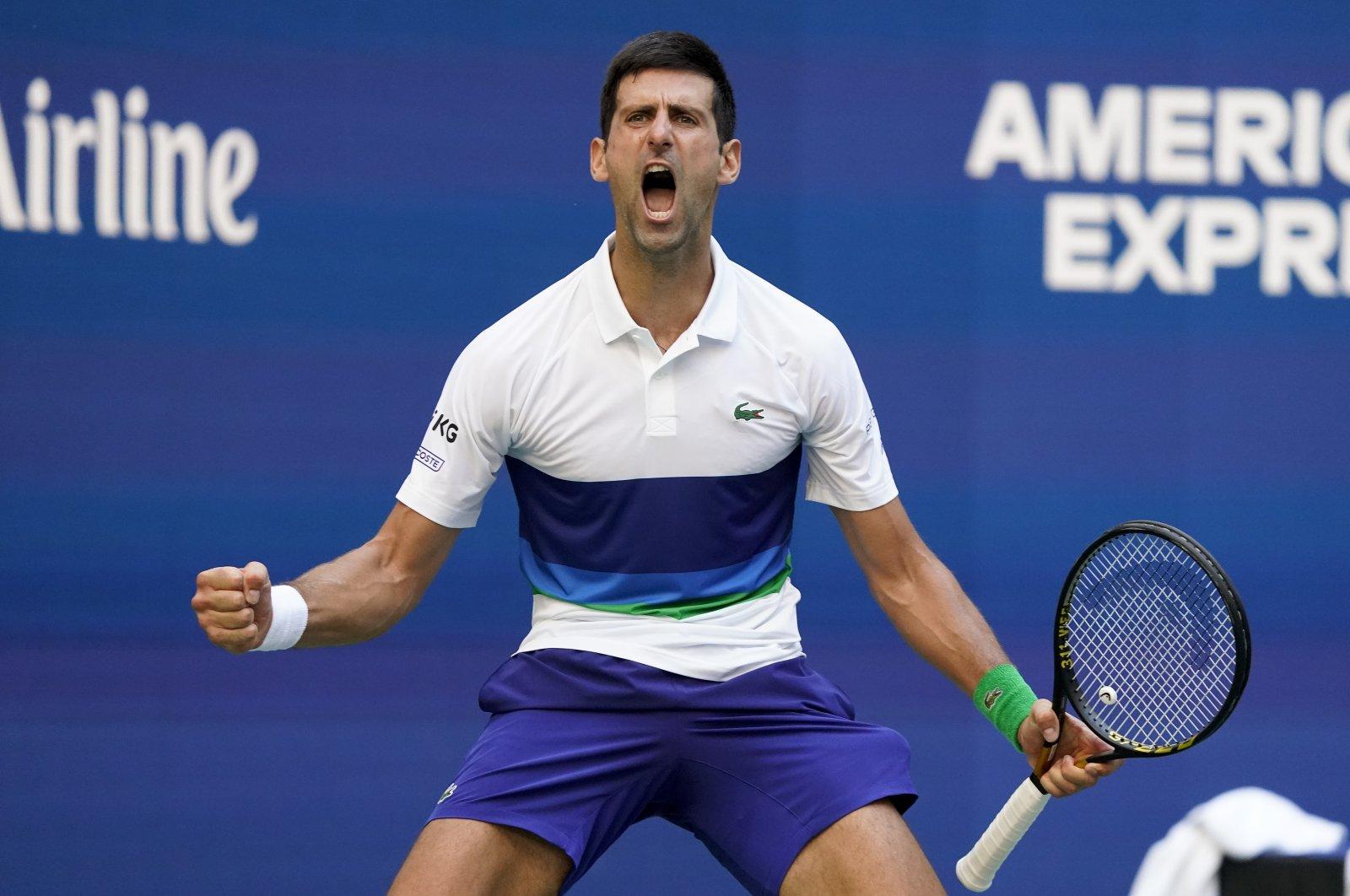 Serbia's Novak Djokovic reacts after scoring a point against Japan's Kei Nishikori in their U.S. Open third-round match, New York, U.S., Sept. 4, 2021. (AP Photo)