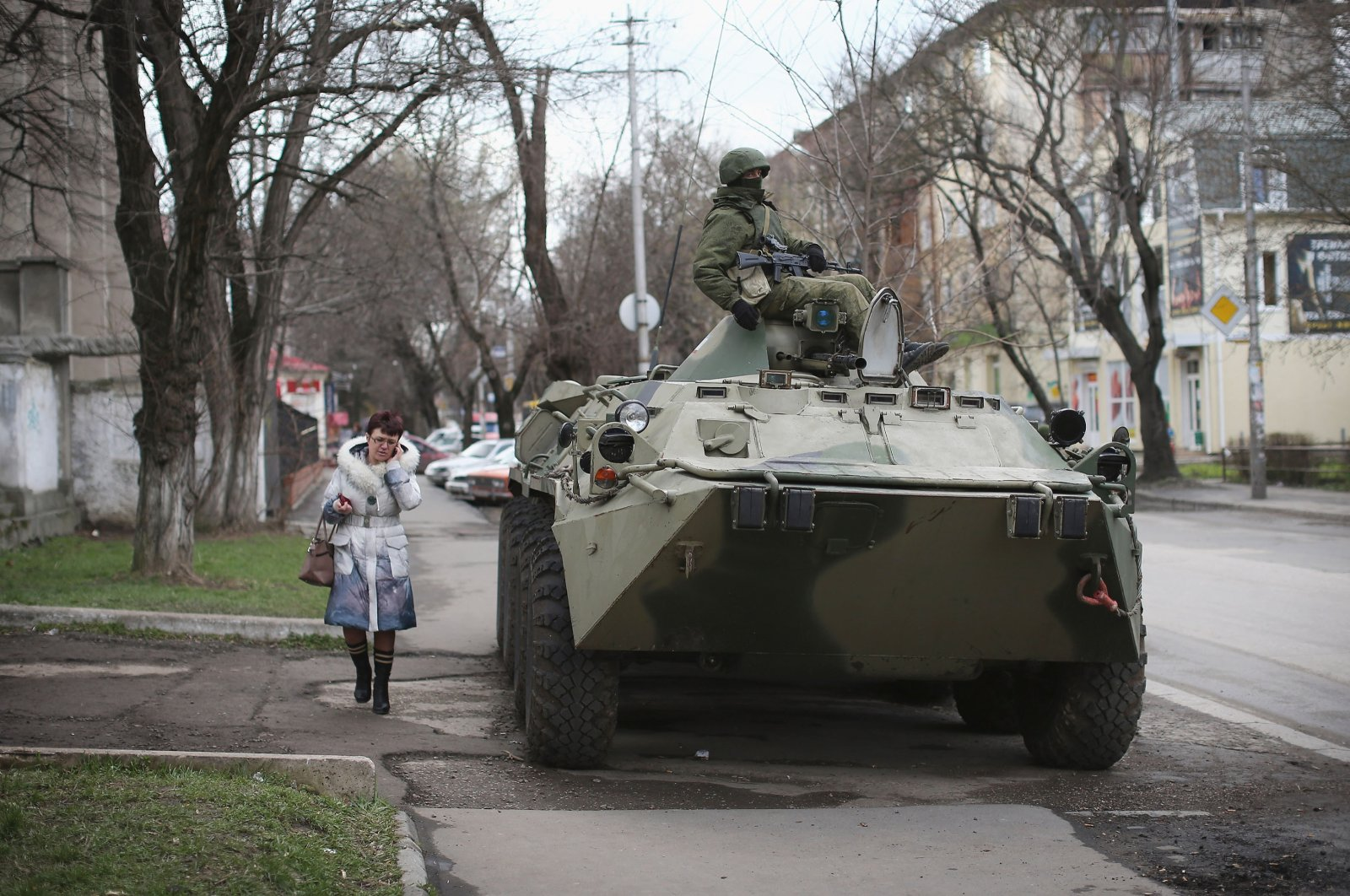 A woman walks past a Russian military personnel carrier outside a Ukrainian military base on March 18, 2014 in Simferopol, Ukraine. (Getty Images)