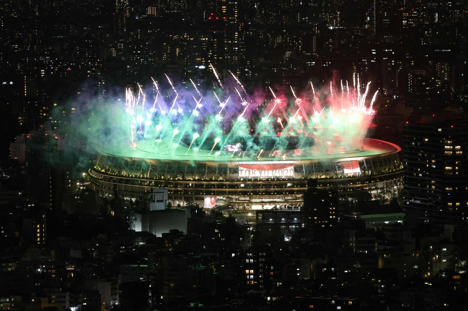 Fireworks light up the sky above the Olympic Stadium during the closing ceremony for the Tokyo 2020 Paralympic Games in Tokyo on September 5, 2021. (Photo by Behrouz MEHRI / AFP)