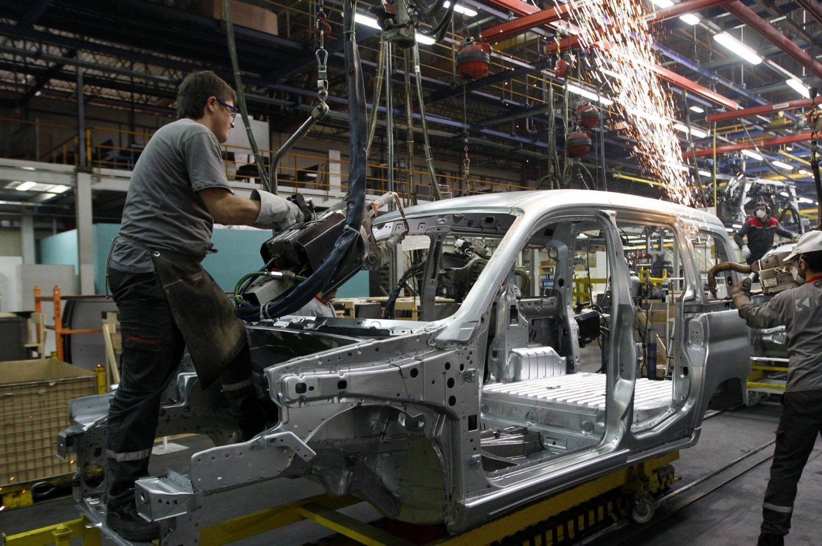 Employees work on the assembly line of the Karsan automotive factory in Bursa, Turkey, Feb. 17, 2011. (Reuters Photo)