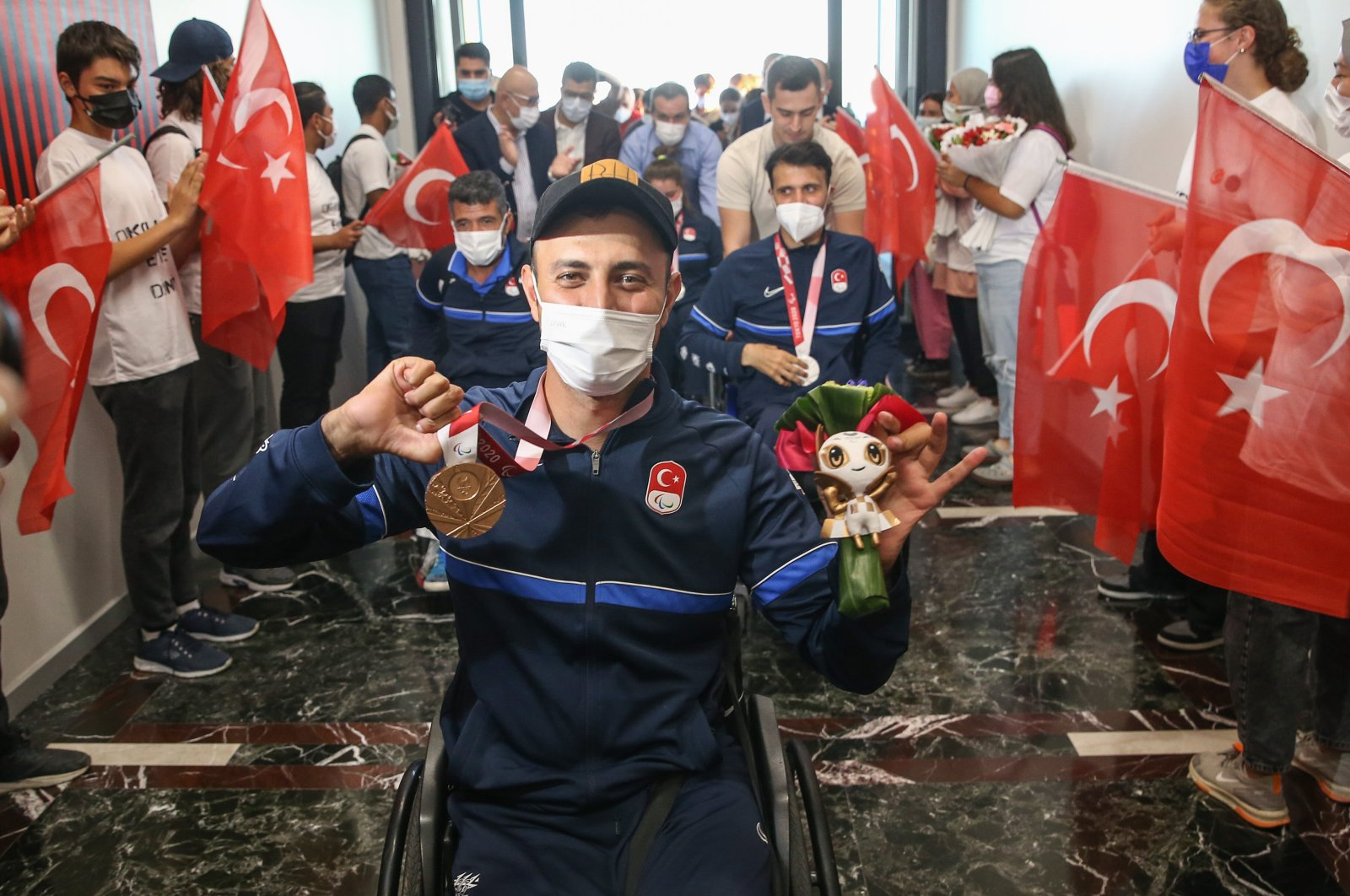 Fans welcome Turkish Paralympic athletes on return to Istanbul Airport, Istanbul, Turkey, Sept. 2, 2021. (AA Photo)