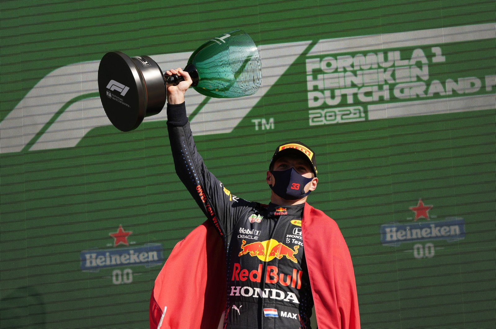Red Bull's Max Verstappen celebrates on the podium after winning the Formula One Dutch Grand Prix at the Circuit Zandvoort, Zandvoort, the Netherlands, Sept. 5, 2021. (Reuters Photo)