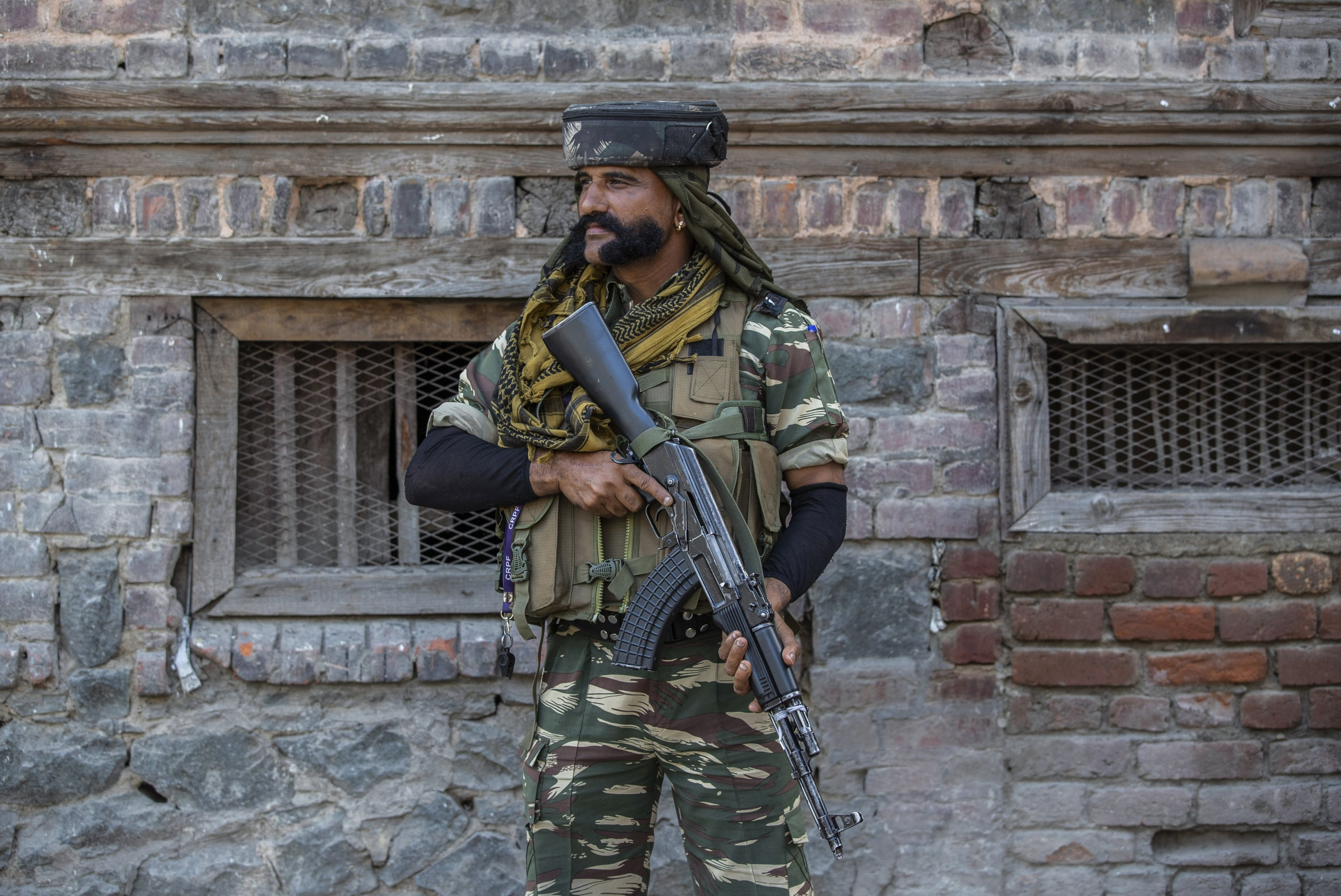 An Indian paramilitary soldier guards a deserted street in Srinagar, Indian-controlled Kashmir, Sept. 5, 2021. (AP Photo)