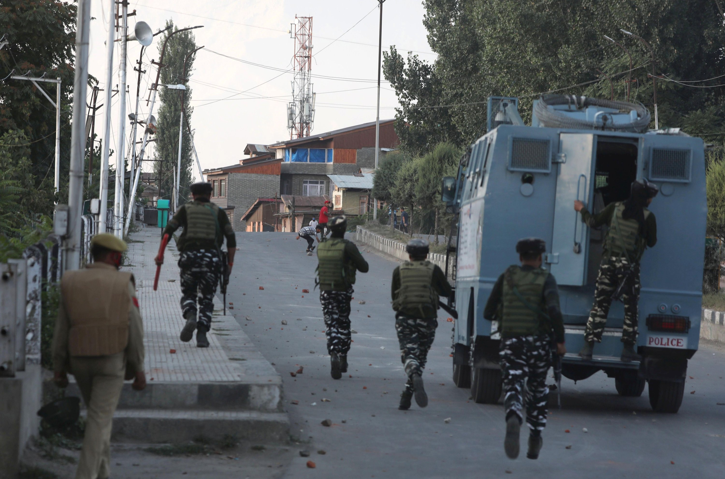 Indian paramilitary soldiers chase Kashmiri Muslim protesters during clashes in Srinagar, Indian-controlled Kashmir, Sept. 2, 2021. (EPA Photo)