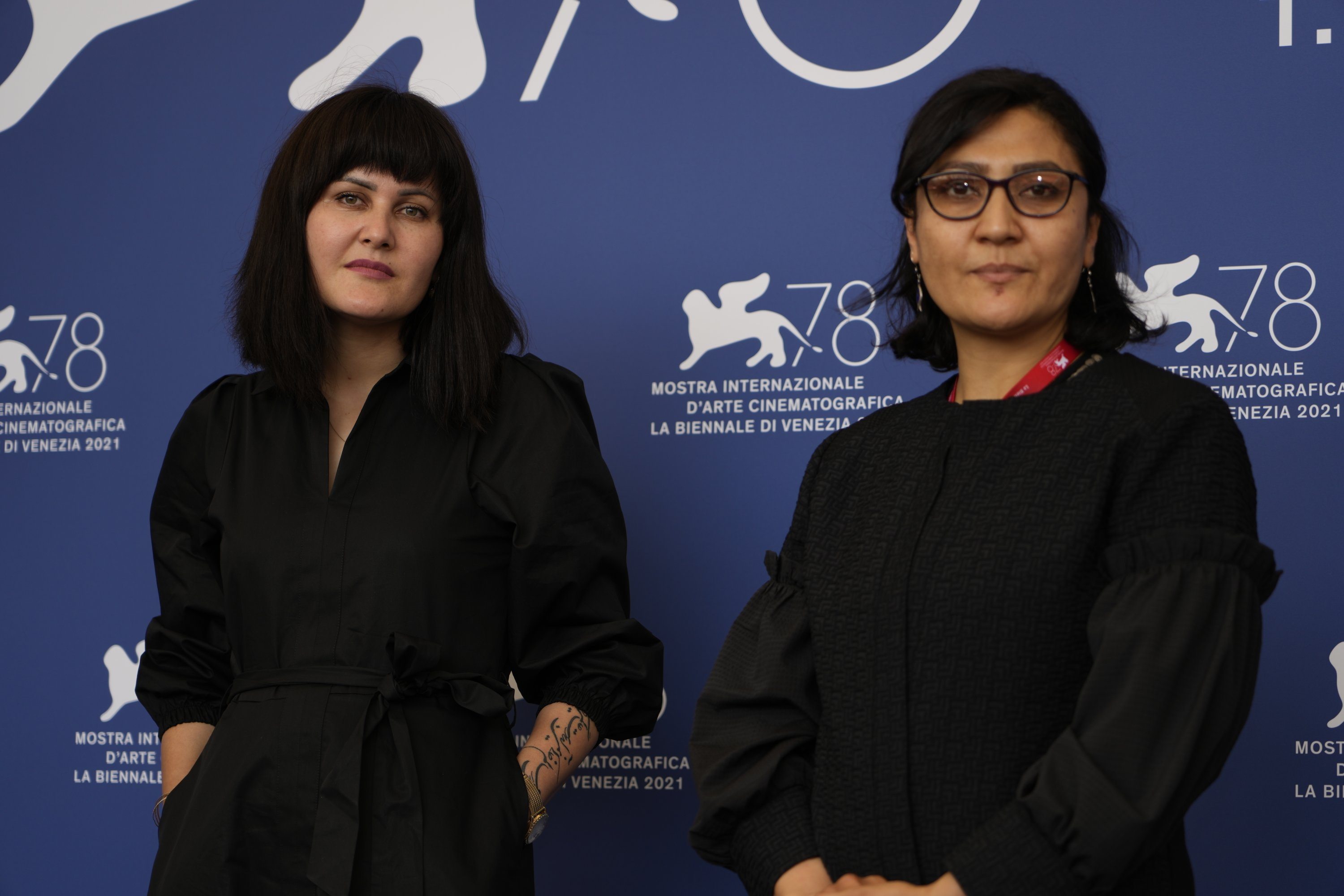 """Directors Sahraa Karimi (L) and Sarah Mani pose at the photo call for the """"International panel on Afghanistan and the situation of Afghan filmmakers and artists"""" at the 78th Venice Film Festival in Venice, Italy, Sept. 4, 2021. (AP Photo)"""
