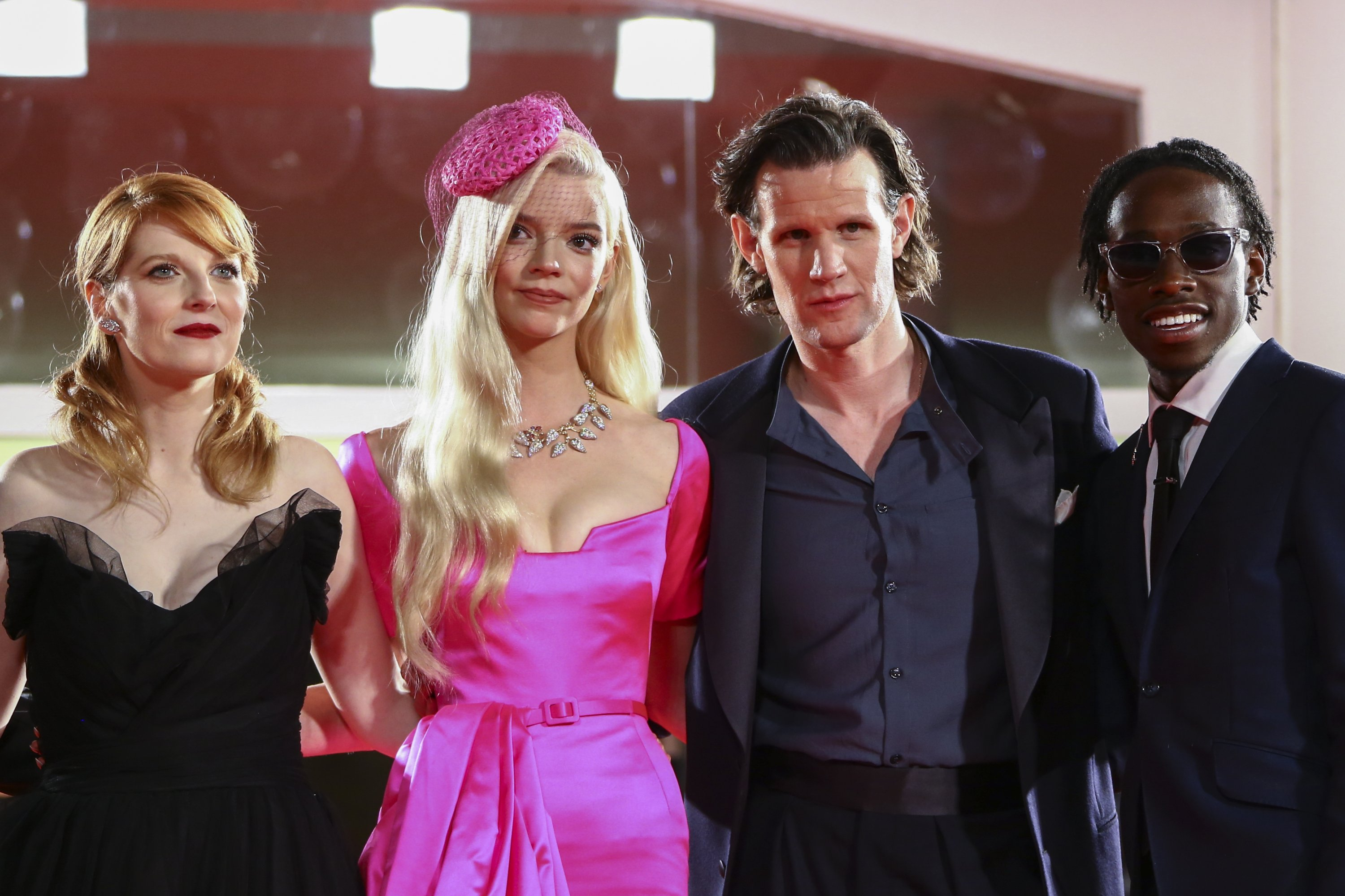 """Krysty Wilson-Cairns (L), Anya Taylor-Joy (C-L), Matt Smith (C-R) and Michael Ajao pose at the premiere of the film """"Last Night in Soho"""" at the 78th Venice Film Festival, in Venice, Italy, Sept. 4, 2021. (AP Photo)"""