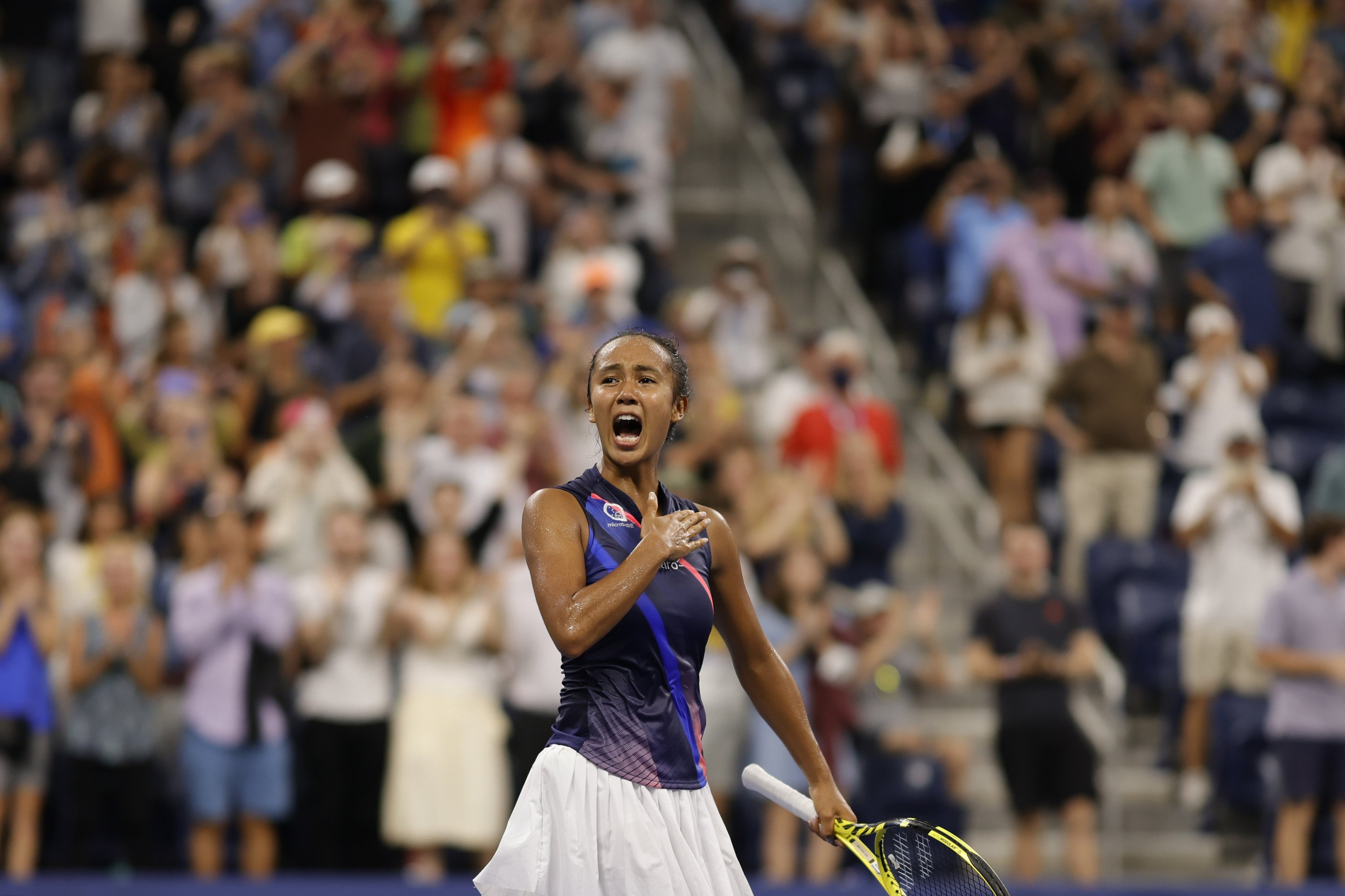 Canada's Leylah Fernandez celebrates after match point against Germany's Angelique Kerber of Germany during their 2021 U.S. Open women's singles fourth-round match, New York, U.S., Sept. 5, 2021.