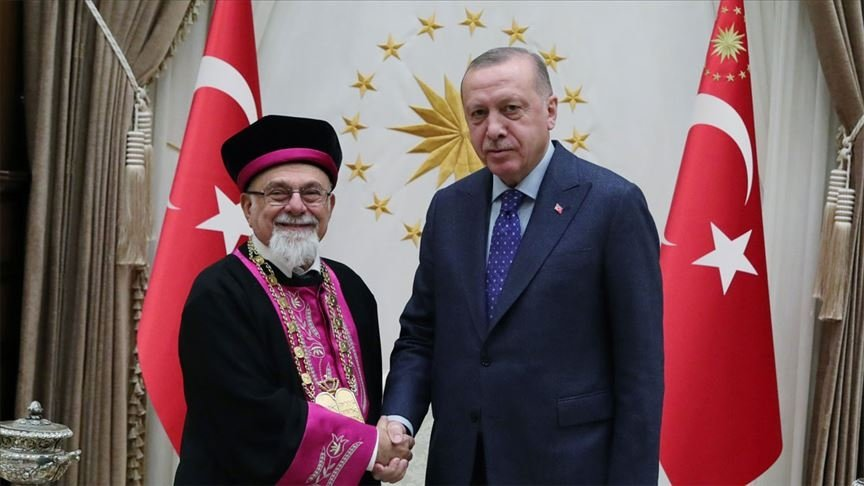 President Recep Tayyip Erdoğan shakes hands with Isak Haleva, chief rabbi of Turkey's Jewish community, during the latter's visit to the presidential complex, in the capital Ankara, Turkey, Jan. 30, 2020. (AA PHOTO)