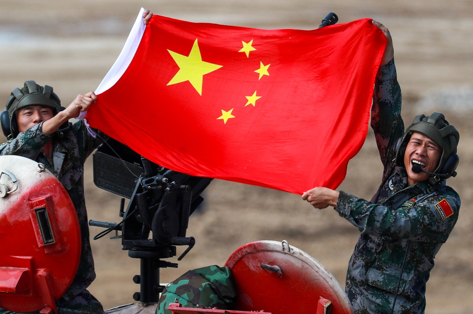 People's Liberation Army (PLA) soldiers pose with a Chinese flag on a TYPE 96B tank during the Tank Biathlon Contest at the 2021 International Army Games at a military training ground in Alabino, Moscow Region. (Sergei Fadeichev / TASS via Reuters)