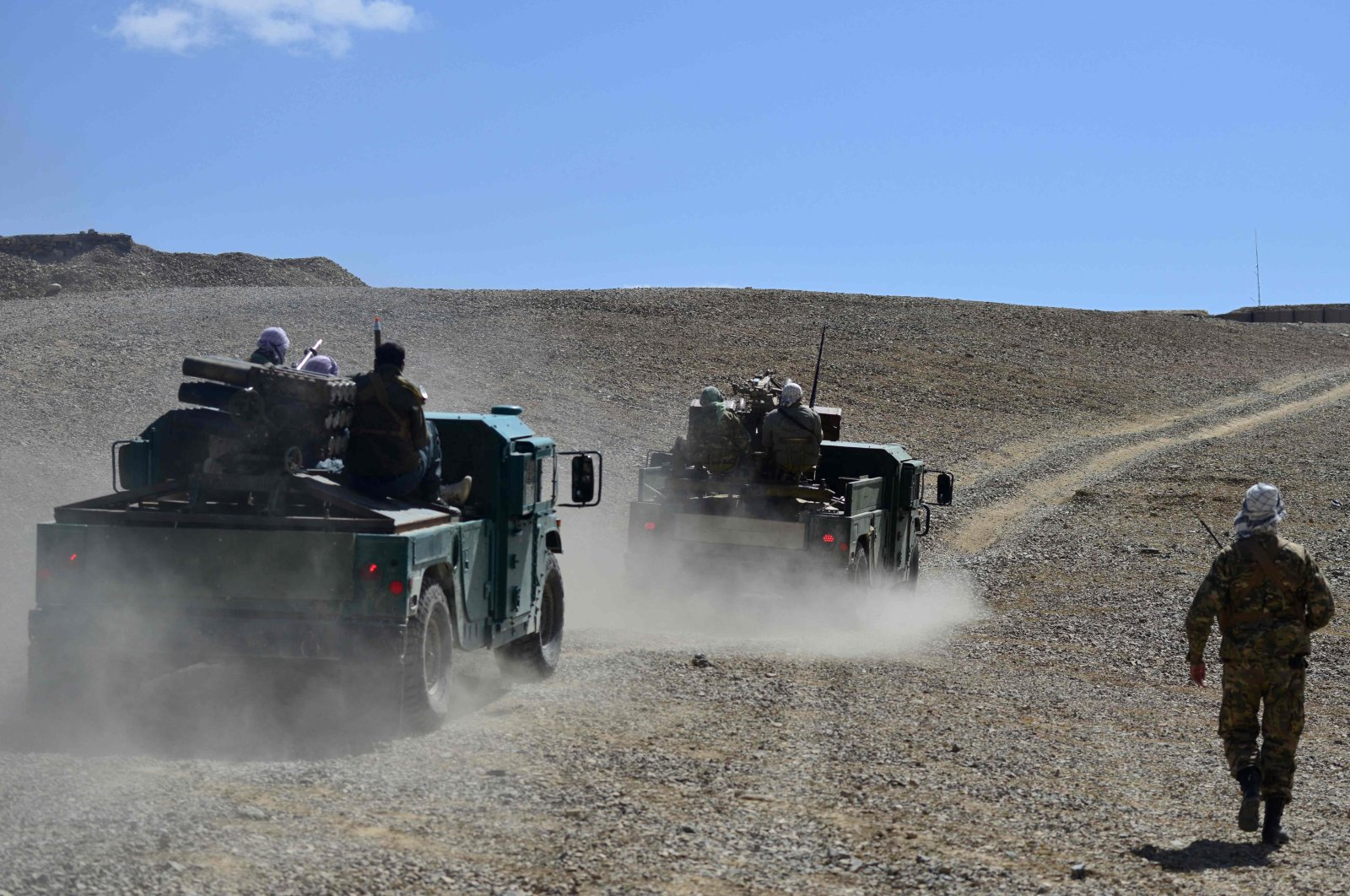 The Afghan resistance movement and anti-Taliban uprising forces personnel patrol in armored humvees at an outpost in Kotal-e Anjuman of the Paryan district in Panjshir province, Afghanistan, Aug. 23, 2021. (AFP Photo)