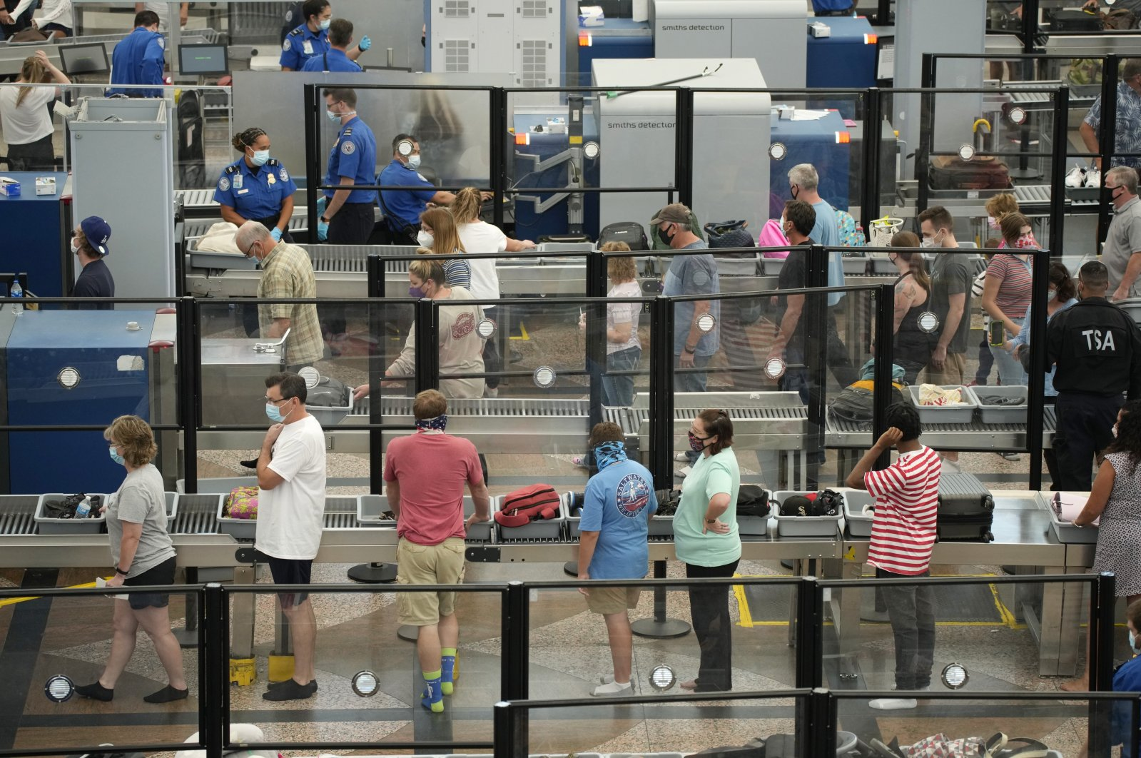 Travelers wear face coverings in the queue for the north security checkpoint in the main terminal of Denver International Airport, Colorado, U.S., Aug. 24, 2021. (AP Photo)