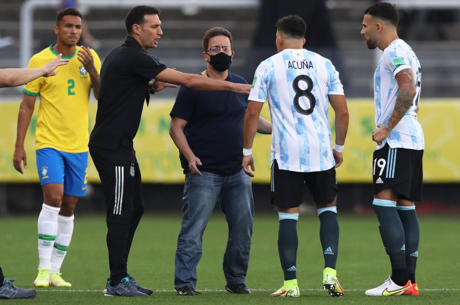 Argentina's Marcos Acuna (2nd R), Nicolas Otamendi (R) argue with a Brazilian health official who invaded the pitch claiming three Argentine players broke quarantine rules, Arena Corinthians, Sao Paulo, Brazil, Sept. 5, 2021. (Reuters Photo)