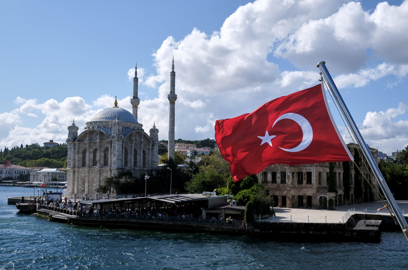 A Turkish flag is pictured on a boat with the Ortaköy Mosque in the background in Istanbul, Turkey, Sept. 5, 2021. (Reuters Photo)
