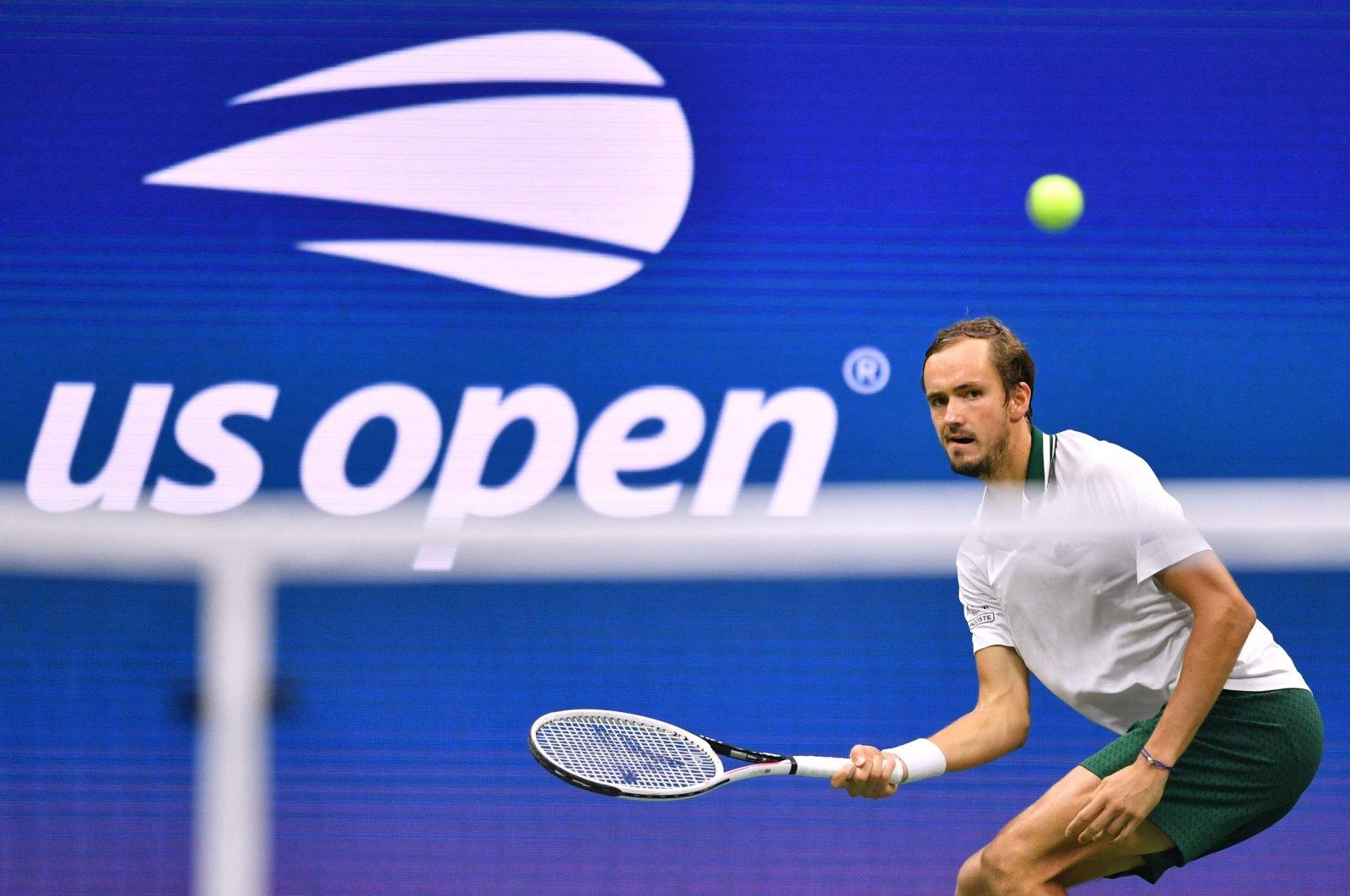 Russia's Daniil Medvedev hits a return to Britain's Daniel Evans during their 2021 U.S. Open Tennis men's singles fourth-round match, New York, U.S., Sept. 5, 2021. (AFP Photo)