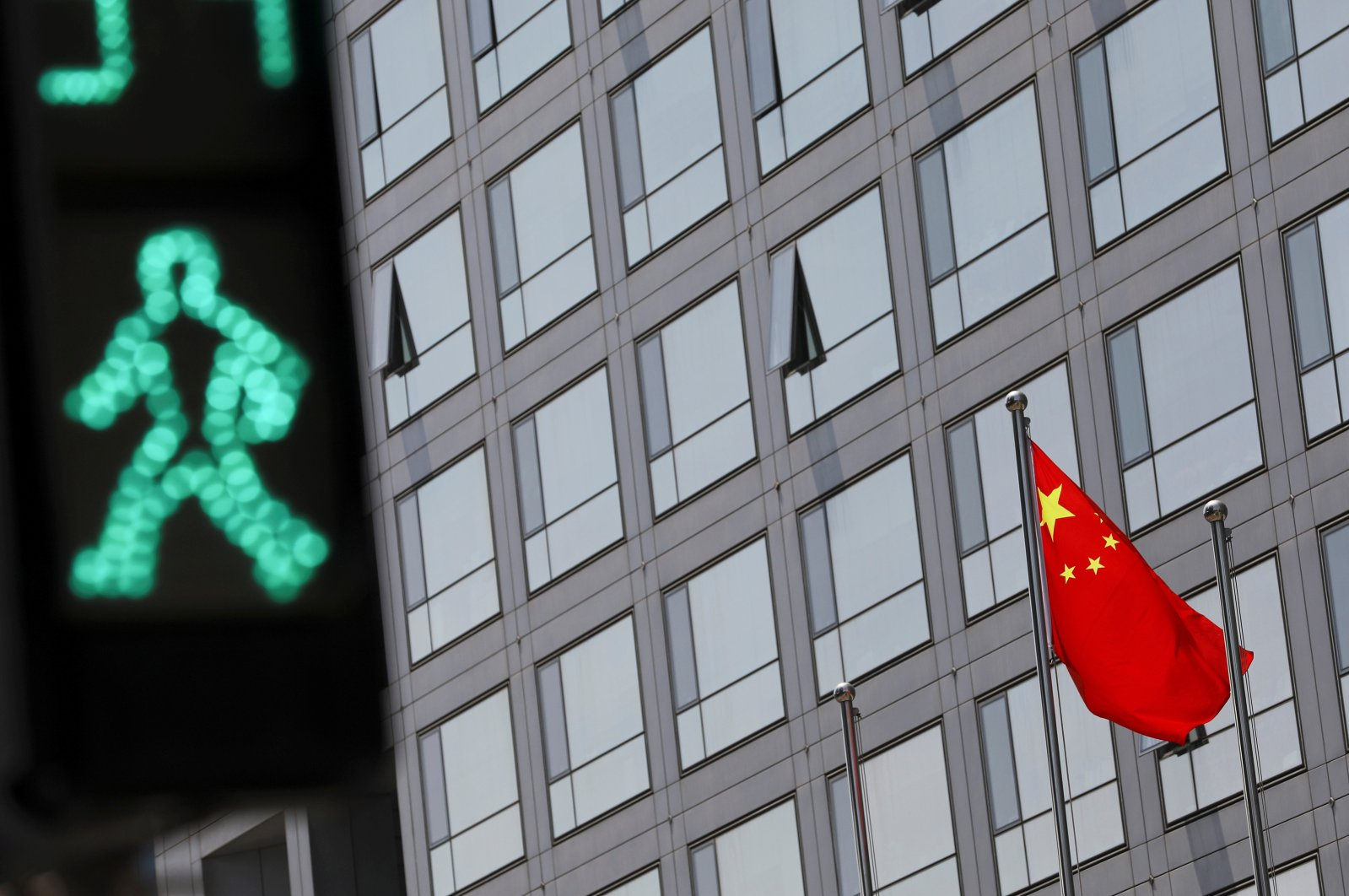 A Chinese national flag flutters outside the China Securities Regulatory Commission (CSRC) building on the Financial Street in Beijing, China, July 9, 2021. (Reuters Photo)
