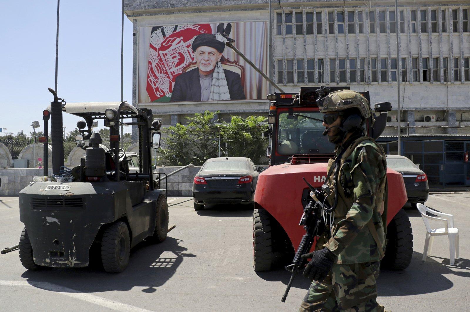 A Taliban soldier patrols at Hamid Karzai International Airport in Kabul, Afghanistan, Sept. 5, 2021. (AP Photo)
