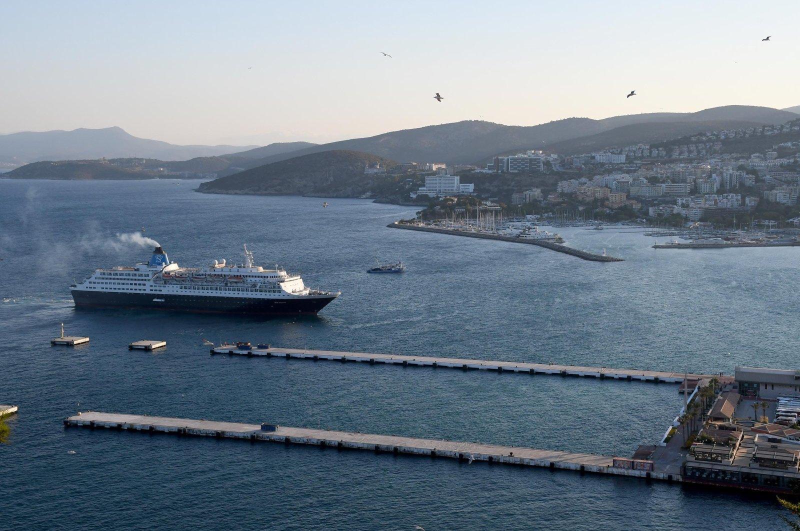 A cruise ship approaches Ege Port on Kuşadası in Aydın province,southwestern Turkey, Sept. 2, 2021. (DHA Photo)
