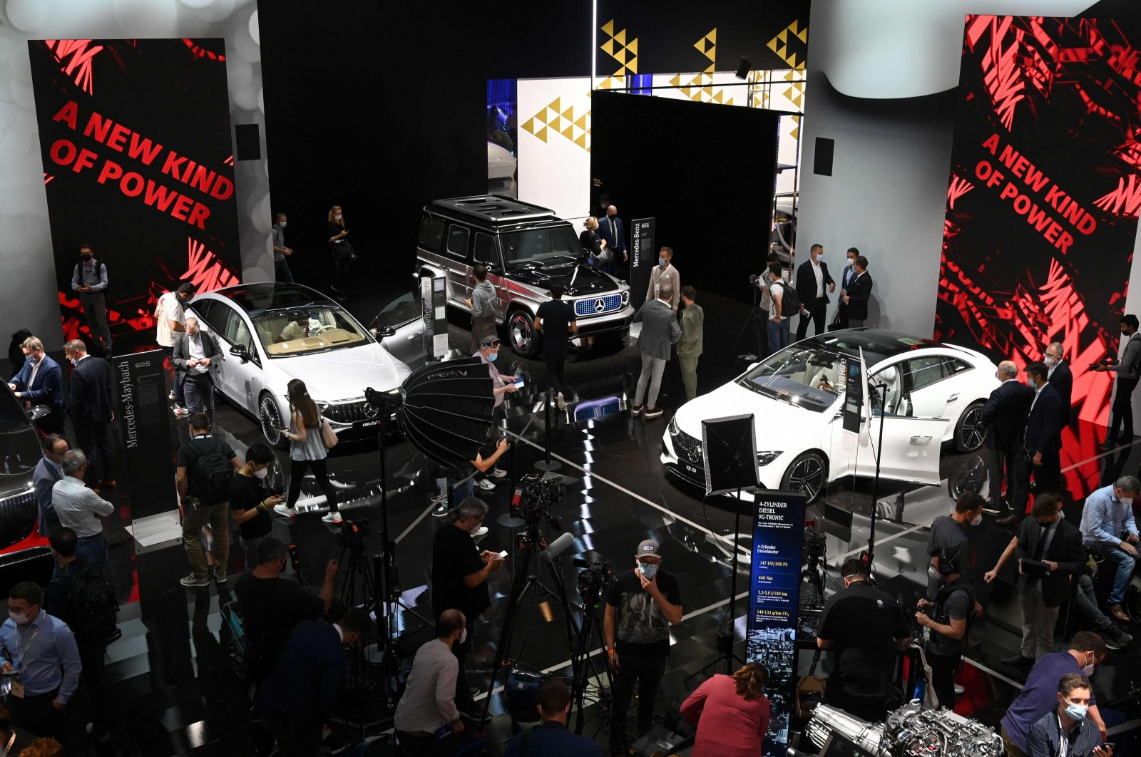 Fairgoers inspect Mercedes cars during a press preview at the International Motor Show (IAA), in Munich, southern Germany, Sept. 6, 2021. (AFP Photo)