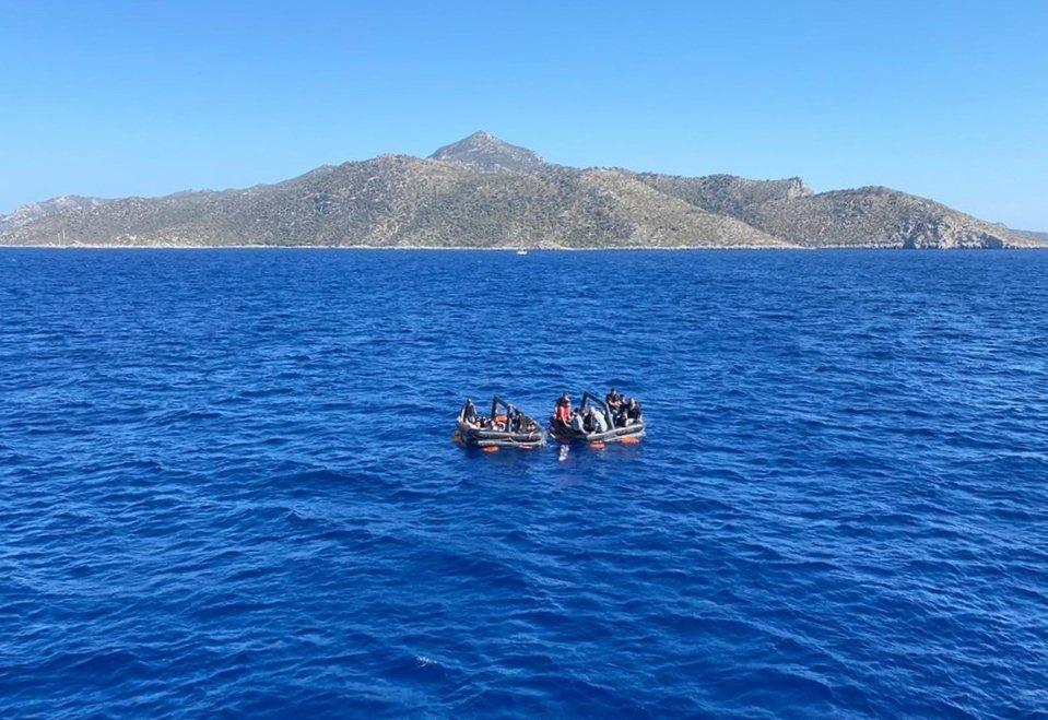 The Turkish Coast Guard Command saves 21 migrants off the Datça district, Monday, Sept. 6, 2021. (IHA Photo)
