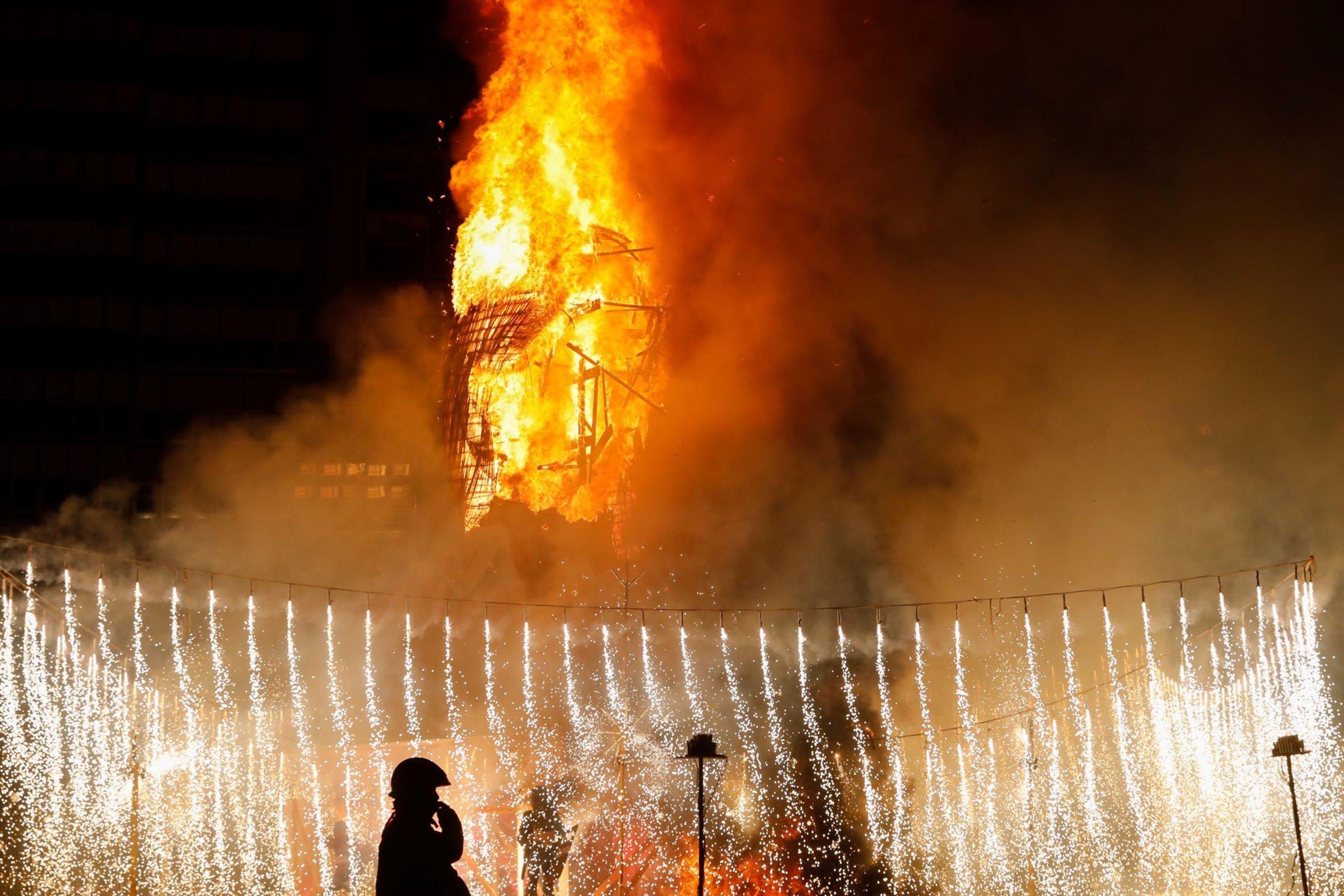 A figure of the municipal Falla, 'La meditadora,' burns during the end of the Fallas festival, in Valencia, Spain, Sept. 5, 2021. (Reuters Photo)