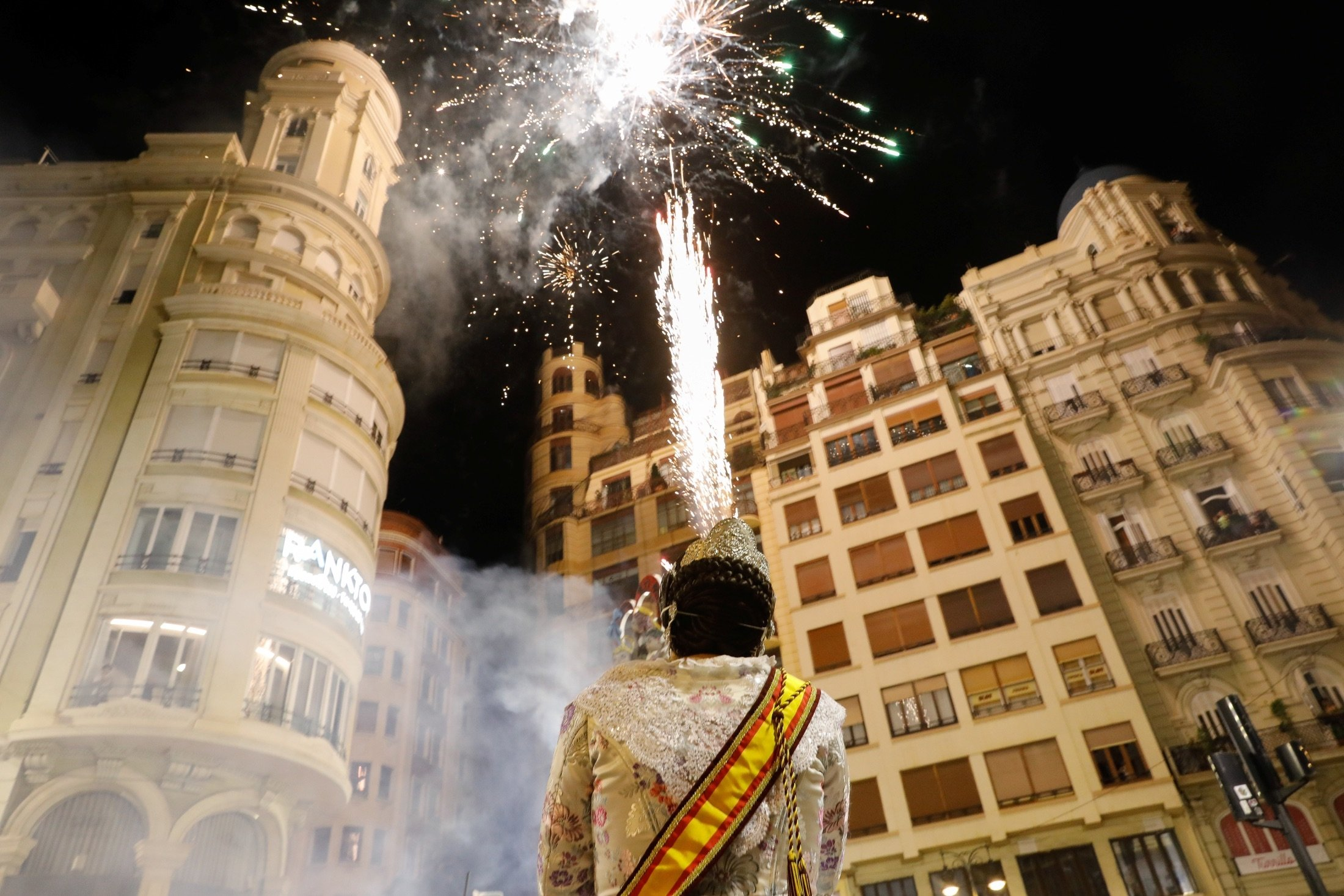 A person watches as figures burn during the end of the Fallas festival, which welcomes Spring and commemorates St. Joseph's Day, in Valencia, Spain, Sept. 5, 2021. (Reuters Photo)