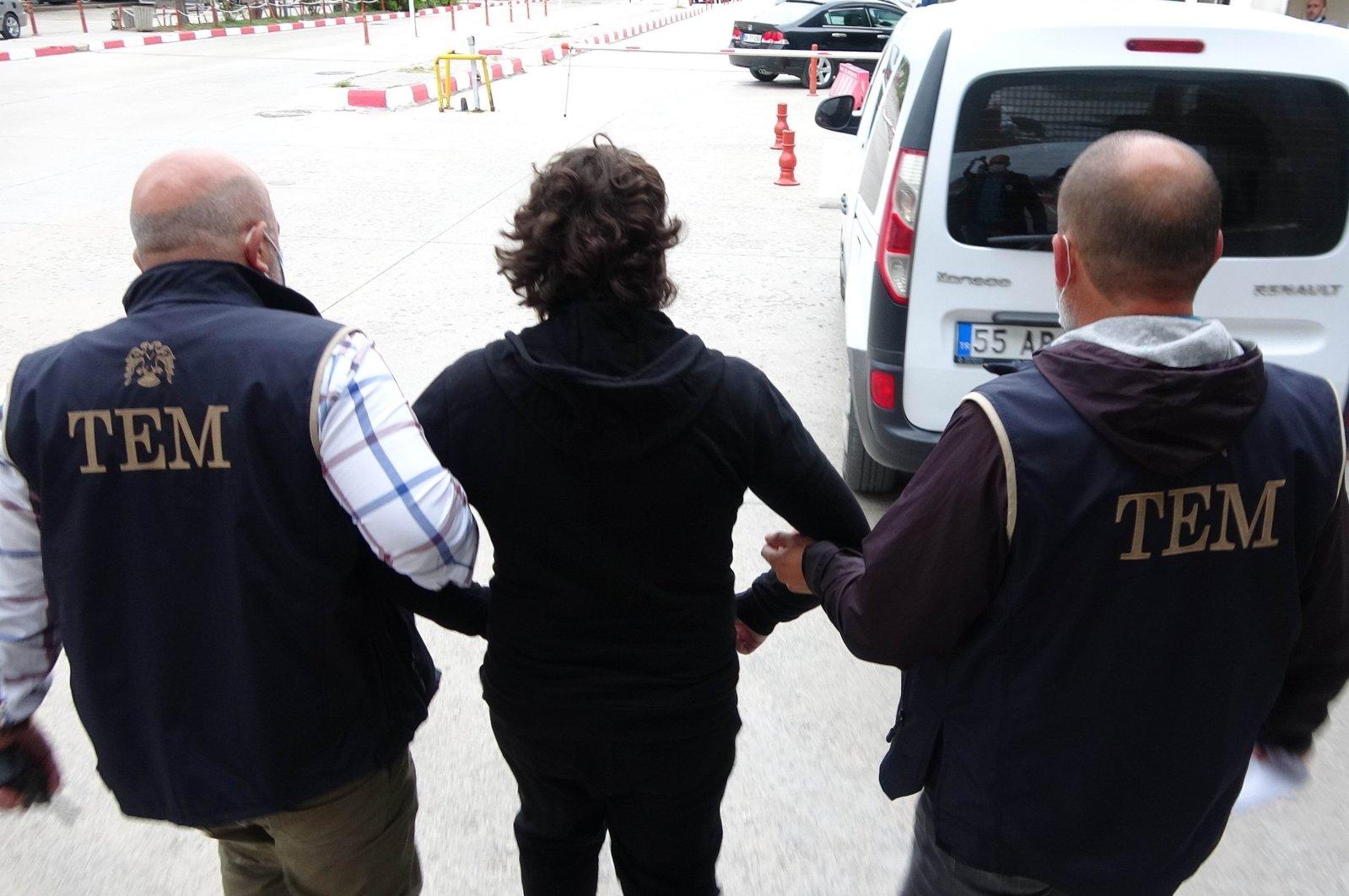Police officers escort a FETÖ suspect captured in Samsun, Turkey, Sept. 7, 2021. (IHA Photo)