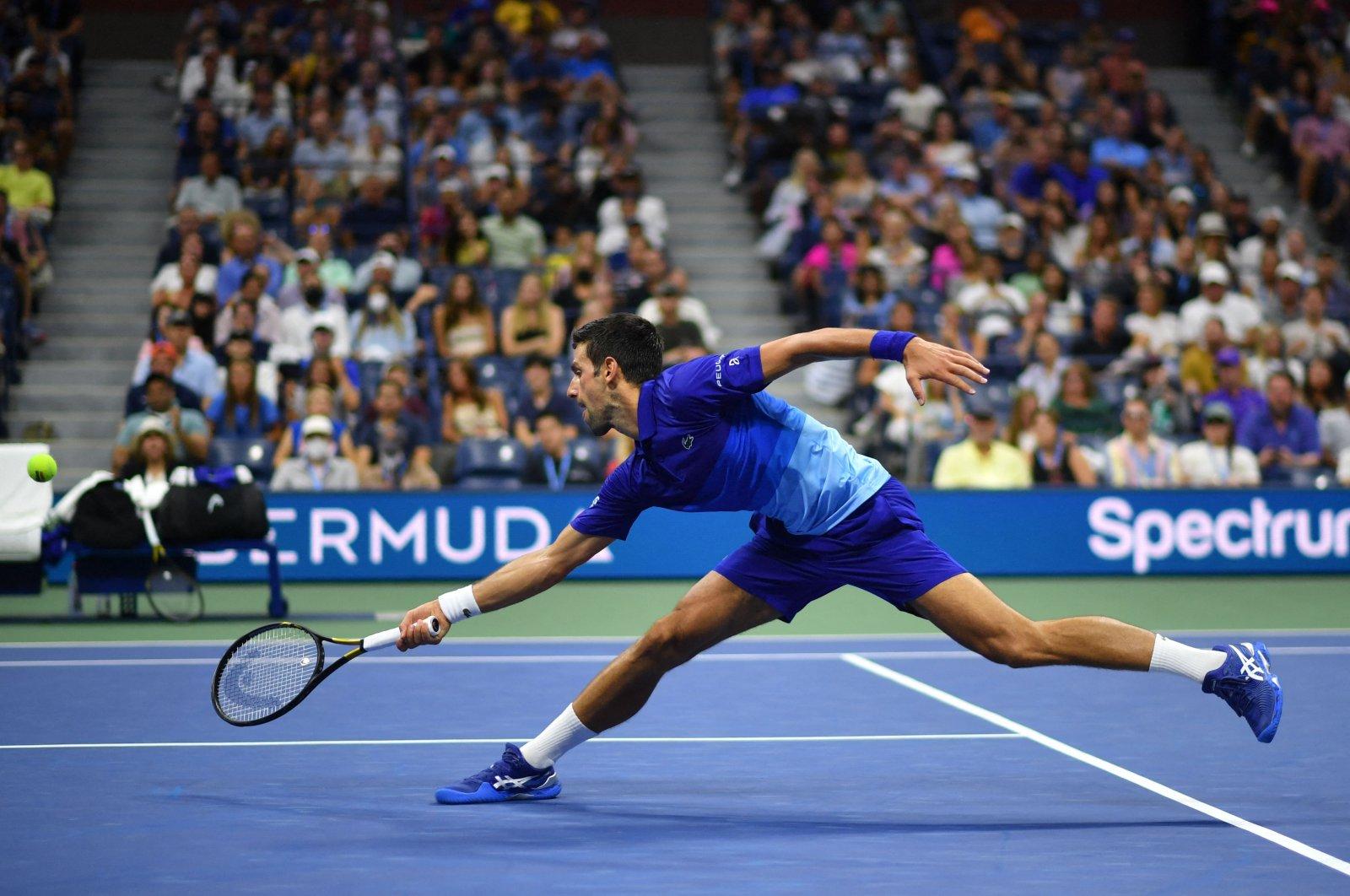 Serbia's Novak Djokovic hits a return to U.S.' Jenson Brooksby during their 2021 U.S. Open men's singles fourth-round match, New York, U.S., Sept. 6, 2021. (AFP Photo)