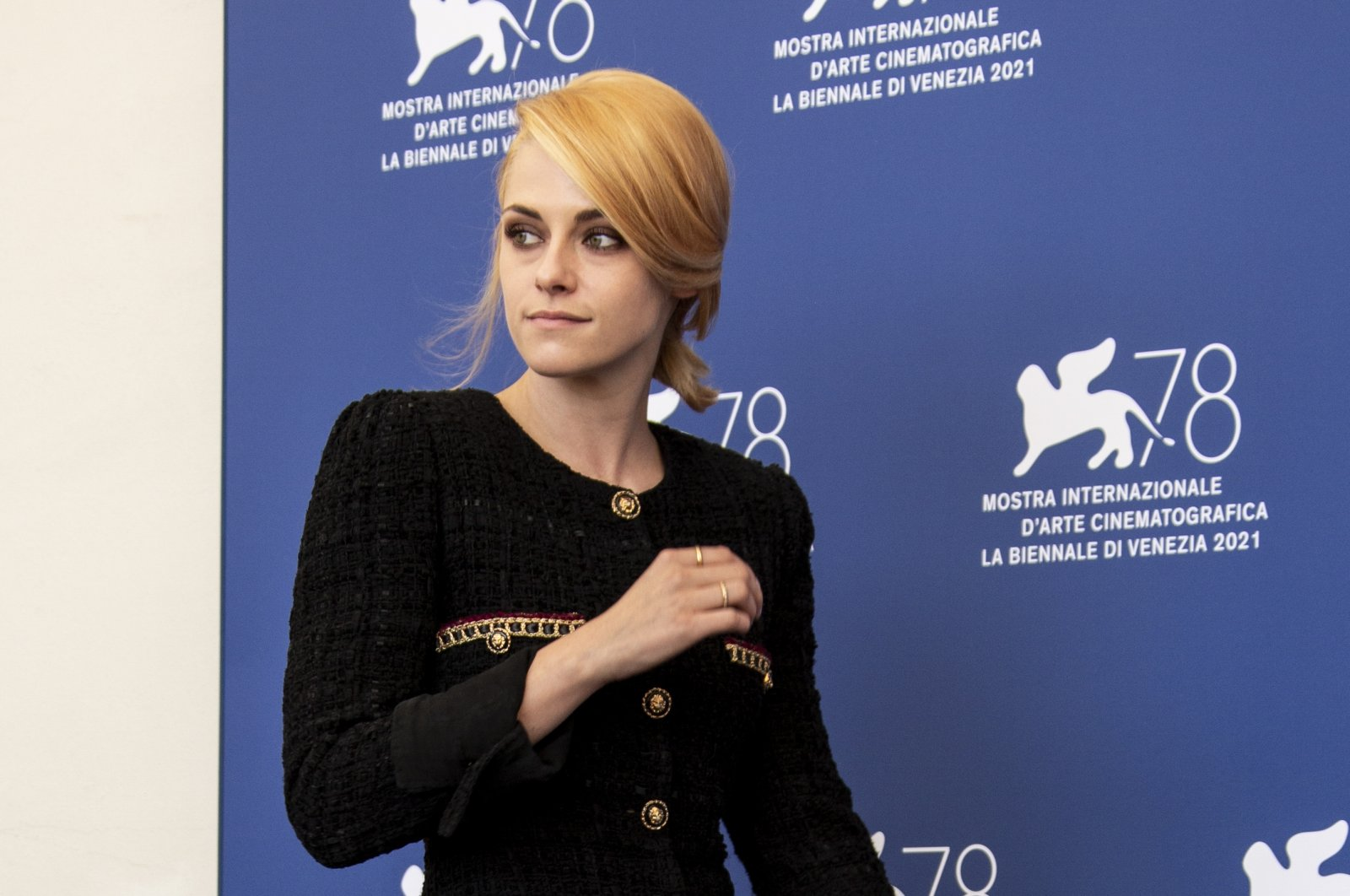 """Kristen Stewart poses for photographers at the photocall for the film """"Spencer"""" at the 78th Venice Film Festival in Venice, Italy, Sept. 3, 2021. (AP Photo)"""