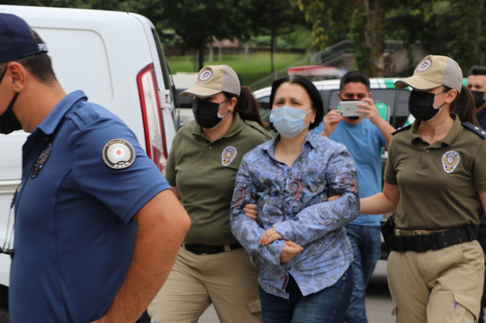 Police escort the suspect after her arrest, in the capital Ankara, Turkey, Aug. 7, 2021. (DHA Photo)